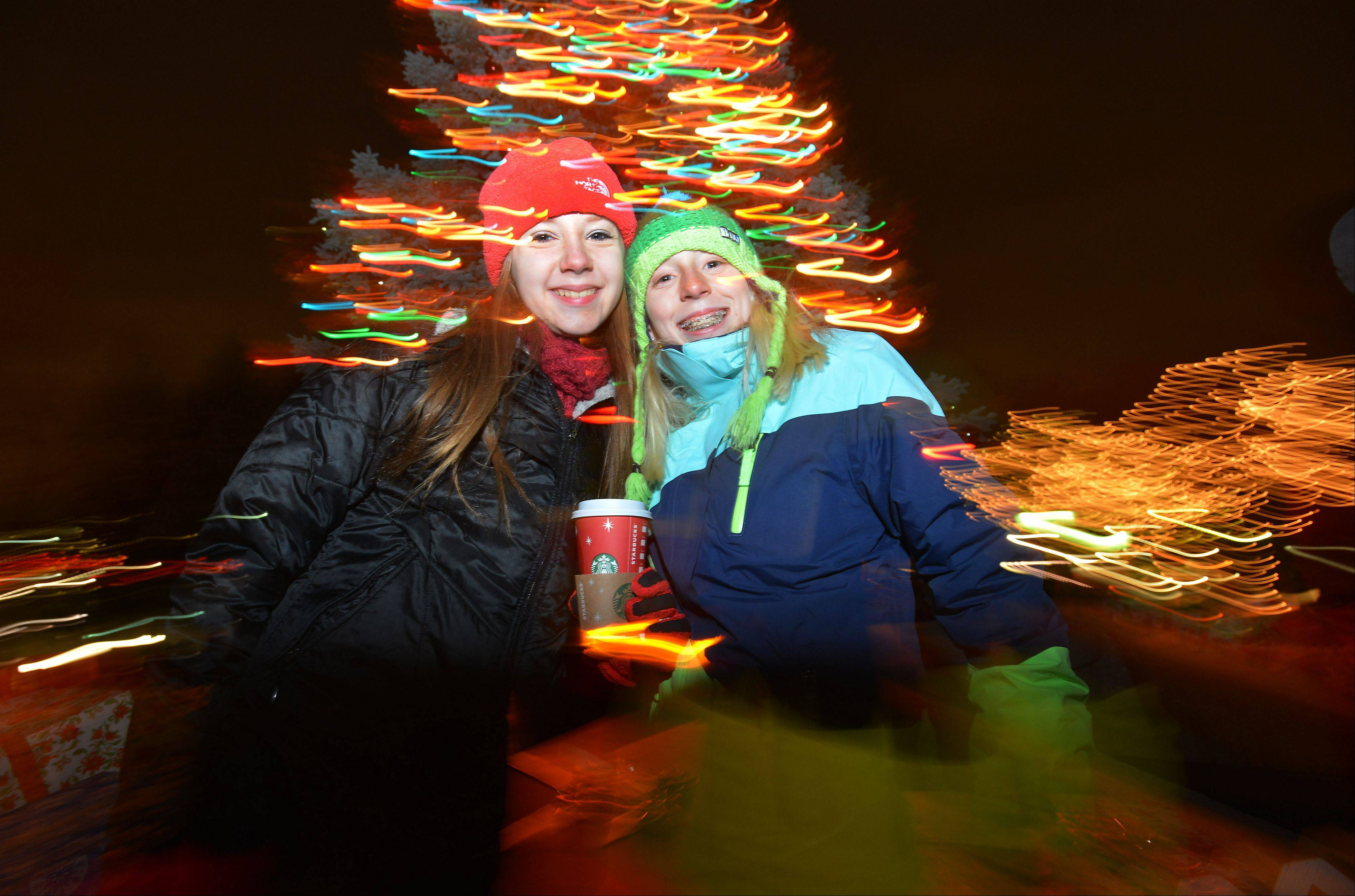 Arlington Heights' Christmas lights were turned on Friday night, and Elisabeth Jaszka and Grace Kozurek, both 13, were right in the thick of things.