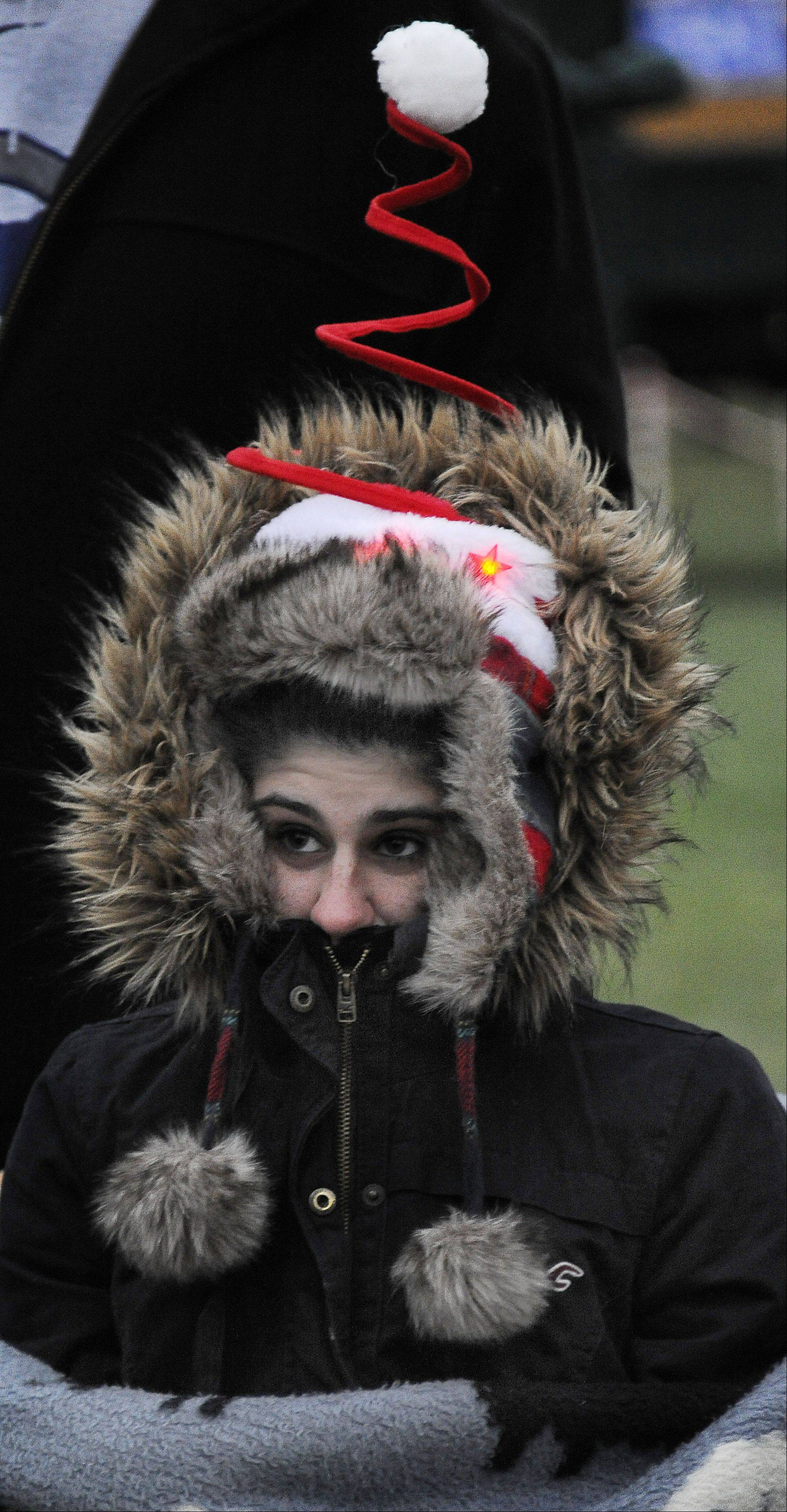 Kailee Falvo, 17, of Hoffman Estates waits in the cold for Arlington Heights' annual tree-lighting festival to start Friday.