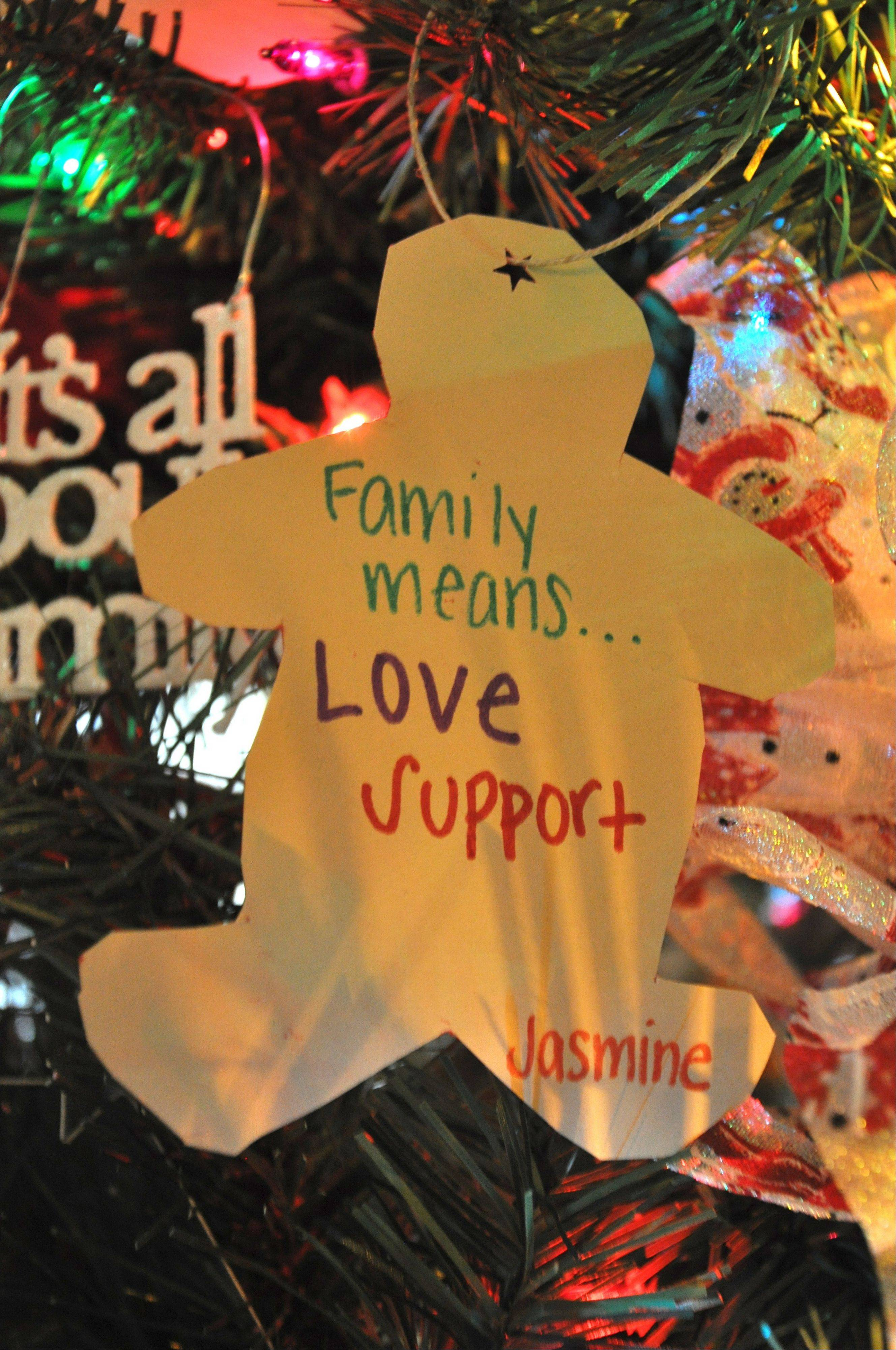 An ornament on the Metropolitan Family Services tree says it all.