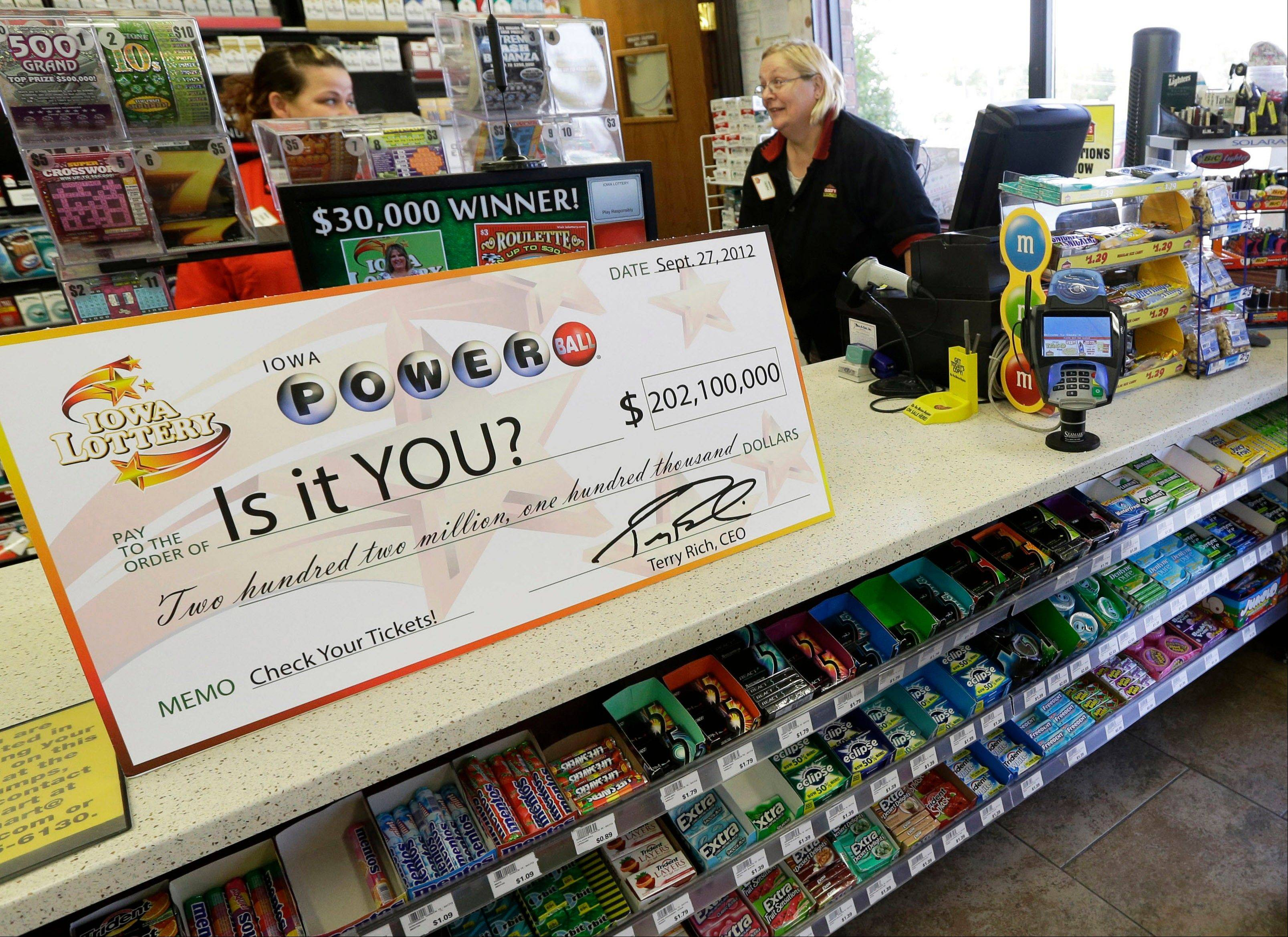 A Powerball promotional check sits on the counter in the Casey's General Store, in Bondurant, Iowa. The jackpot for Powerball�s Saturday, Nov. 24, 2012, drawing has climbed to $325 million, the fourth-largest in the game's history.