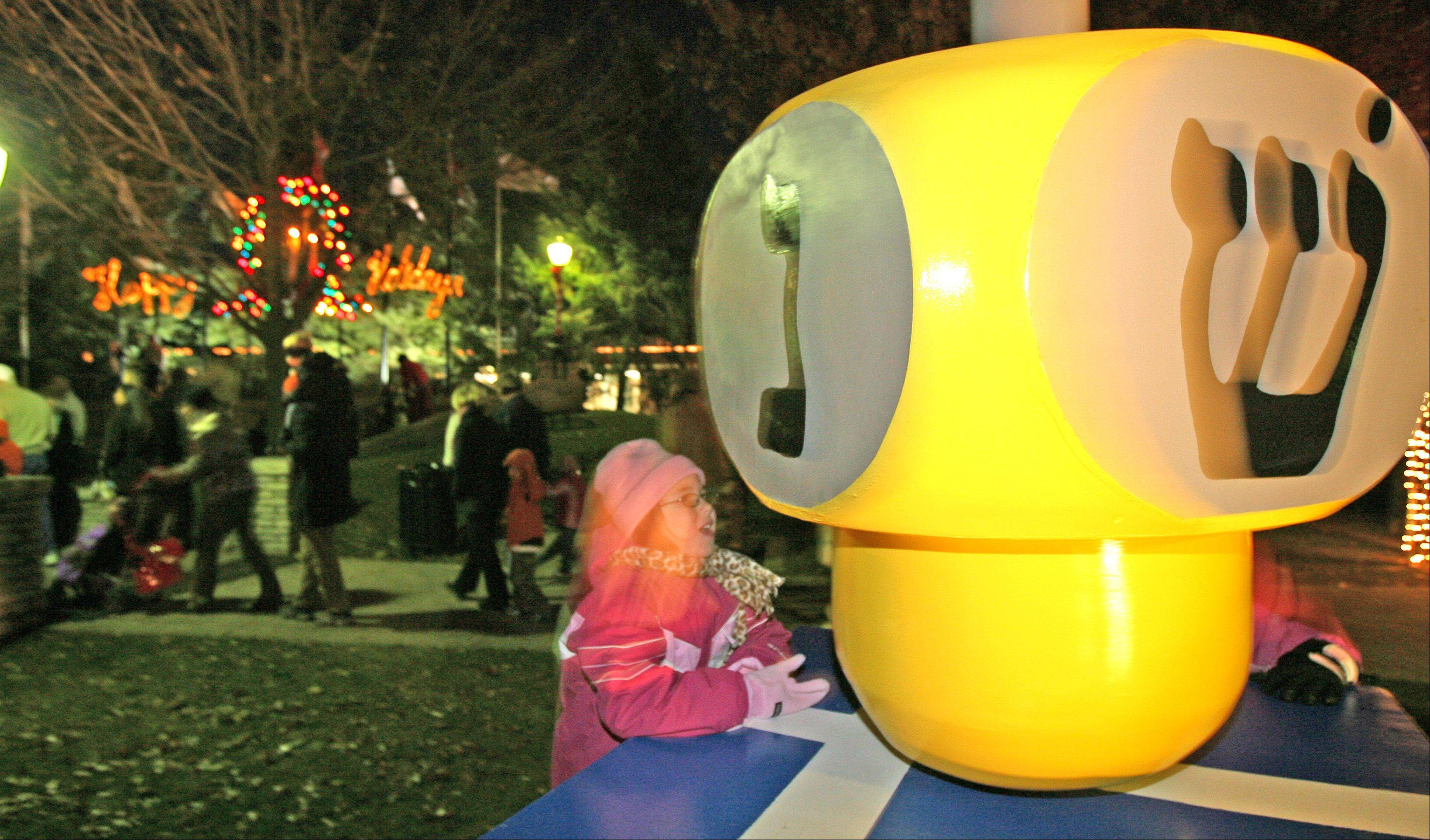 A little girl kisses a dreidel after the lighting ceremony in 2007.