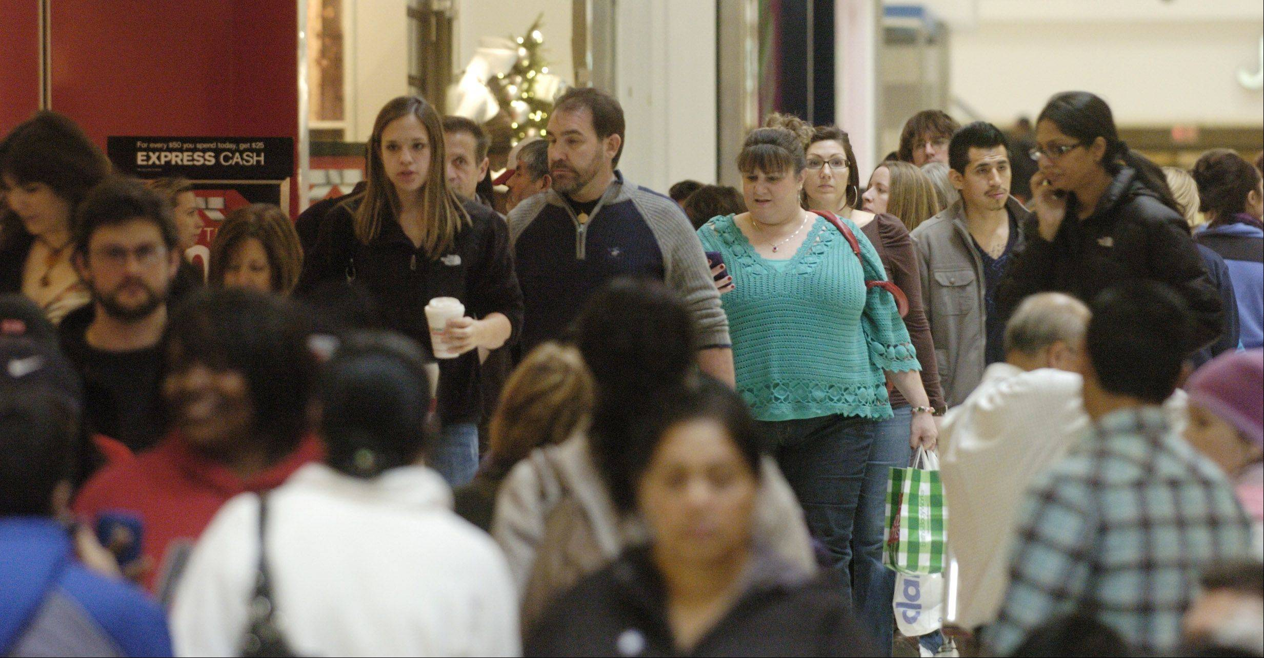 Shoppers look for bargains Woodfield Mall in Schaumburg on Black Friday.