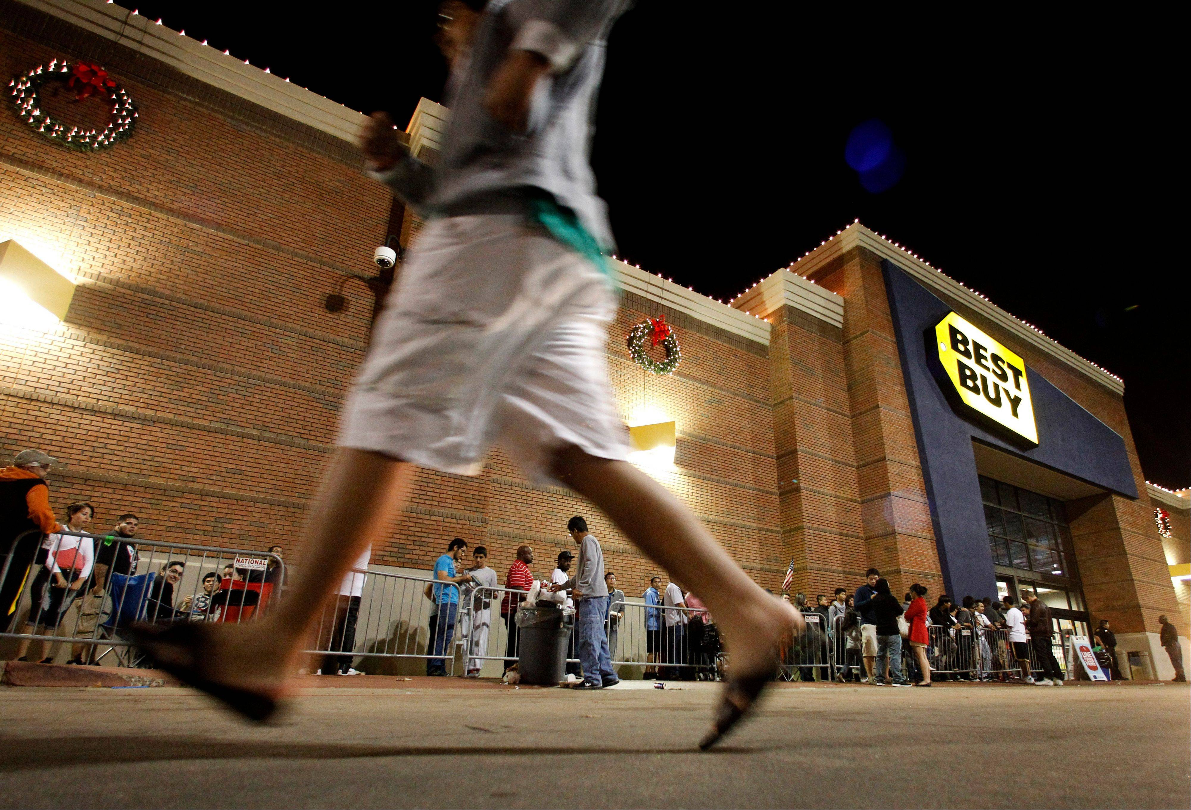 Shoppers stand in line outside a Best Buy department store before the store's opening at midnight for a Black Friday sale, Thursday, Nov. 22, 2012, in Arlington, Texas. Black Friday, the day when retailers traditionally turn a profit for the year, actually got a jump start this year as many stores opened just as families were finishing up Thanksgiving dinner.