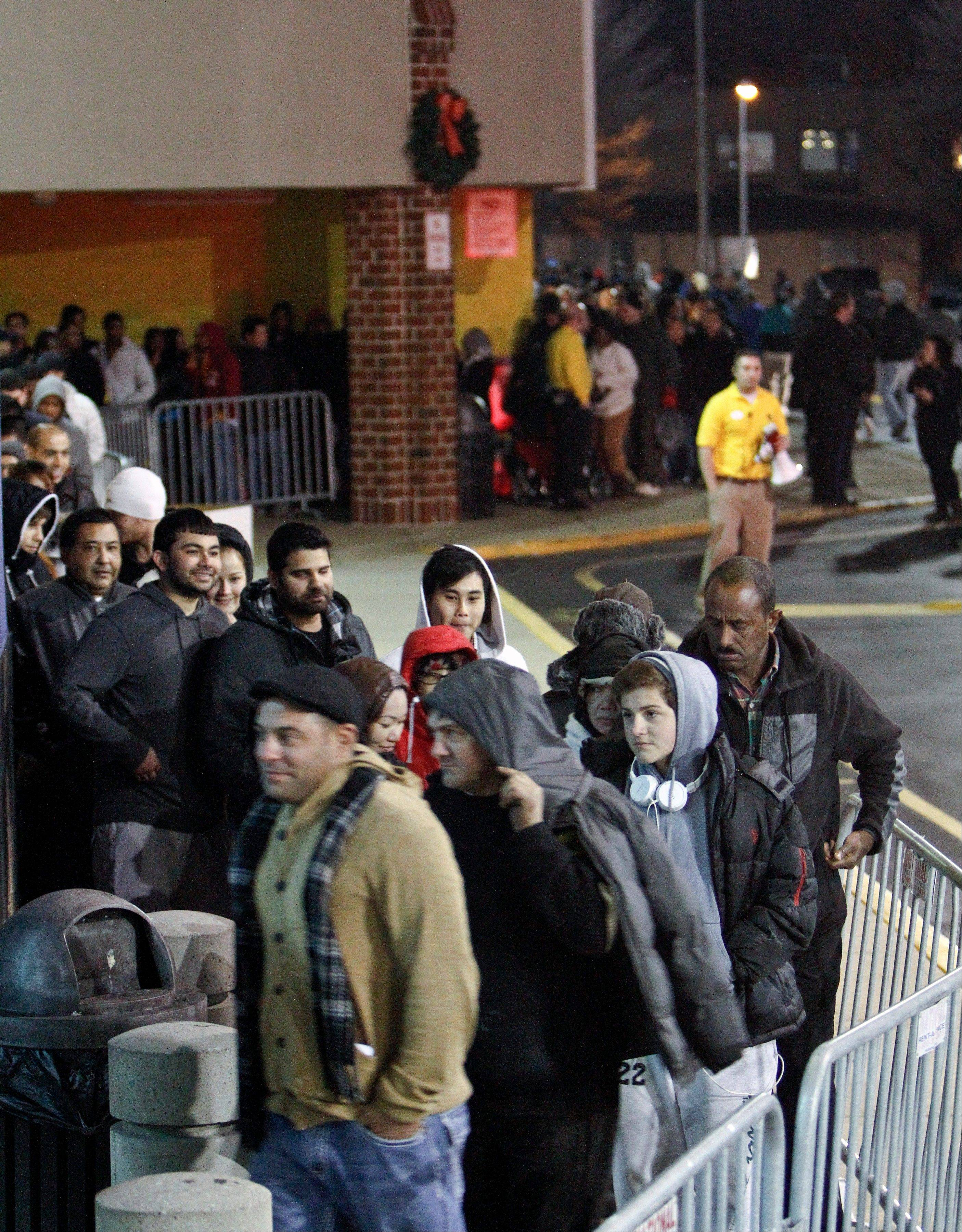 People wait in line, on Thursday Nov 22, 2012, for a Best Buy store in Northeast Philadelphia to open it's doors at midnight.