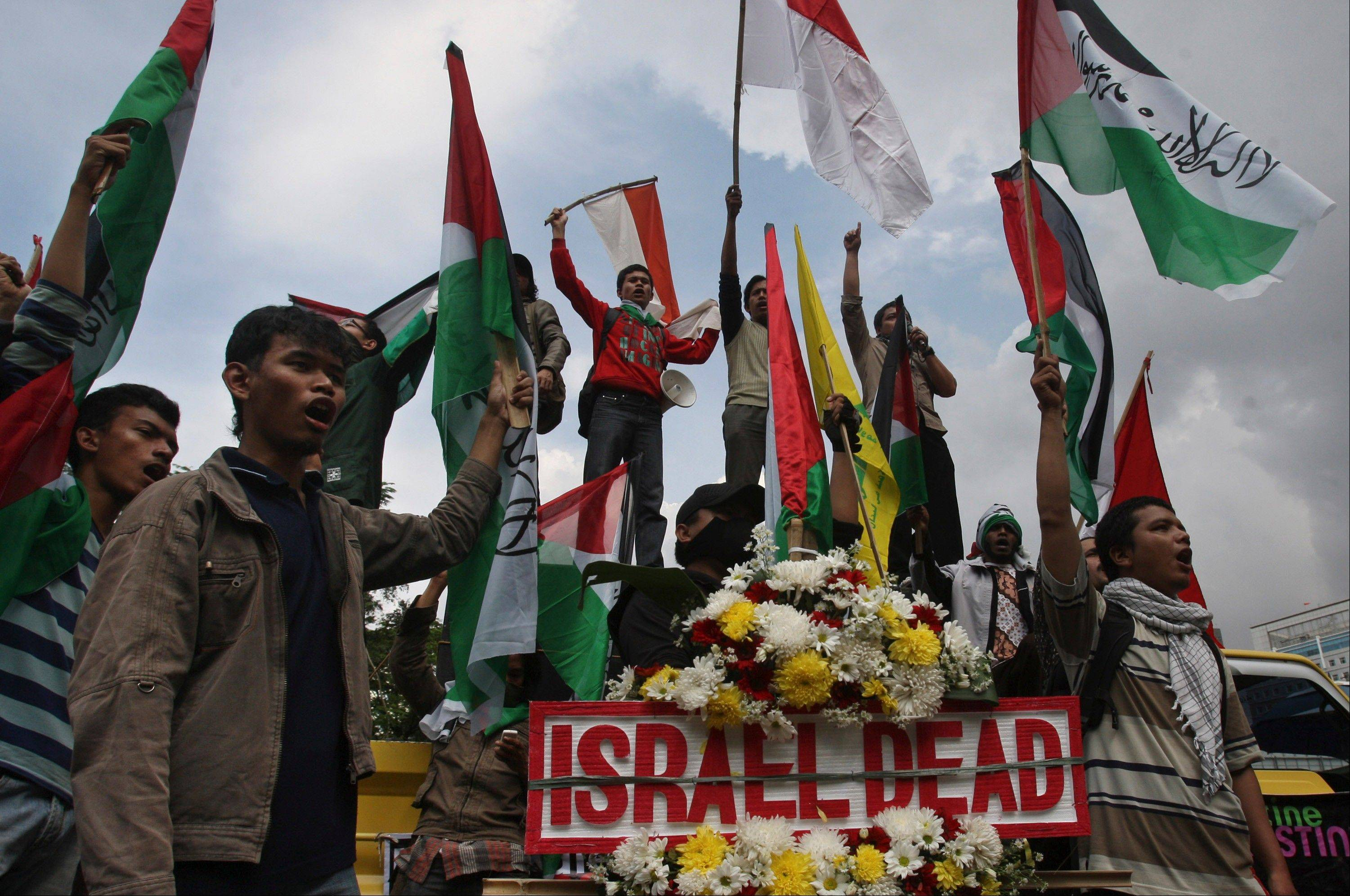 Indonesian Muslim protesters shout slogans during a protest against Israeli military operations in Gaza Strip, outside the U.S. Embassy in Jakarta, Indonesia, Friday, Nov. 23, 2012. More than a thousand Muslim hard-liners held the demonstration to condemn Israel's recent offensive against Palestinians in Gaza.