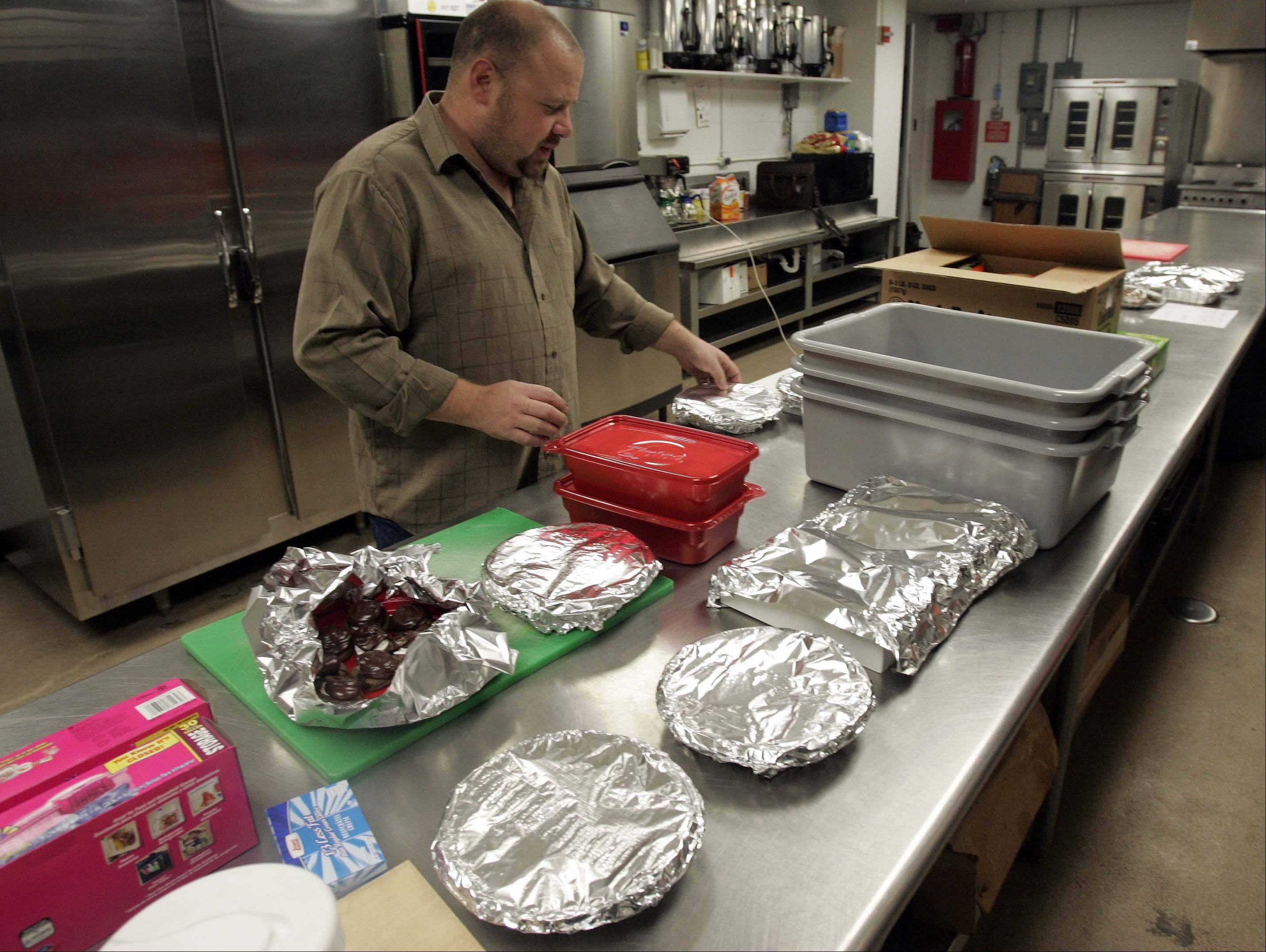 Jeff Turner of In The Neighborhood Deli & Cafe organizes just a few of the desserts for Elgin's Thanksgiving Community Dinner at the Hemmens Cultural Center. Turner gets help from 200 volunteers to staff the event each Thanksgiving.
