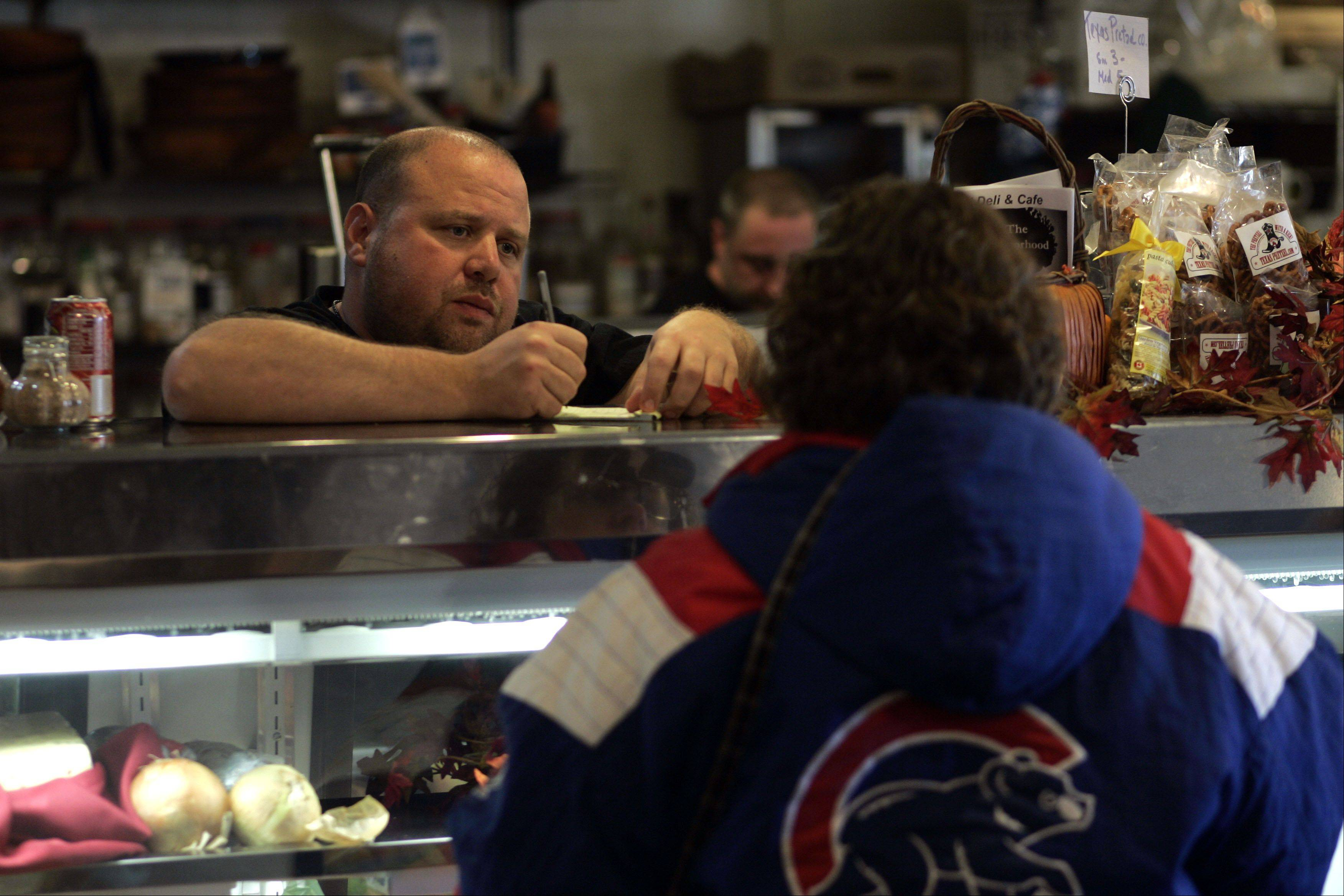 Jeff Turner of ITN Deli in Elgin takes an order for a Hemmens, a sandwich he says is one of his most popular.