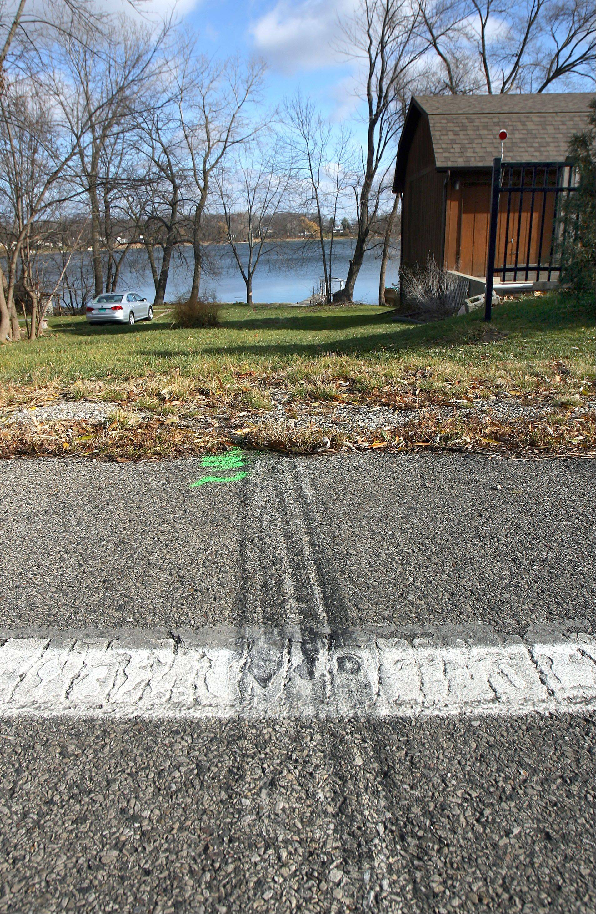 Tire tracks lead east off Engle Drive to Lake Miltmore near Lake Villa. Police are investigating how an SUV left the road early Friday and ended up in Lake Miltmore. The driver, Nicholas Bonilla, 18, of Lindenhurst was trapped in the vehicle and drowned, officials said.