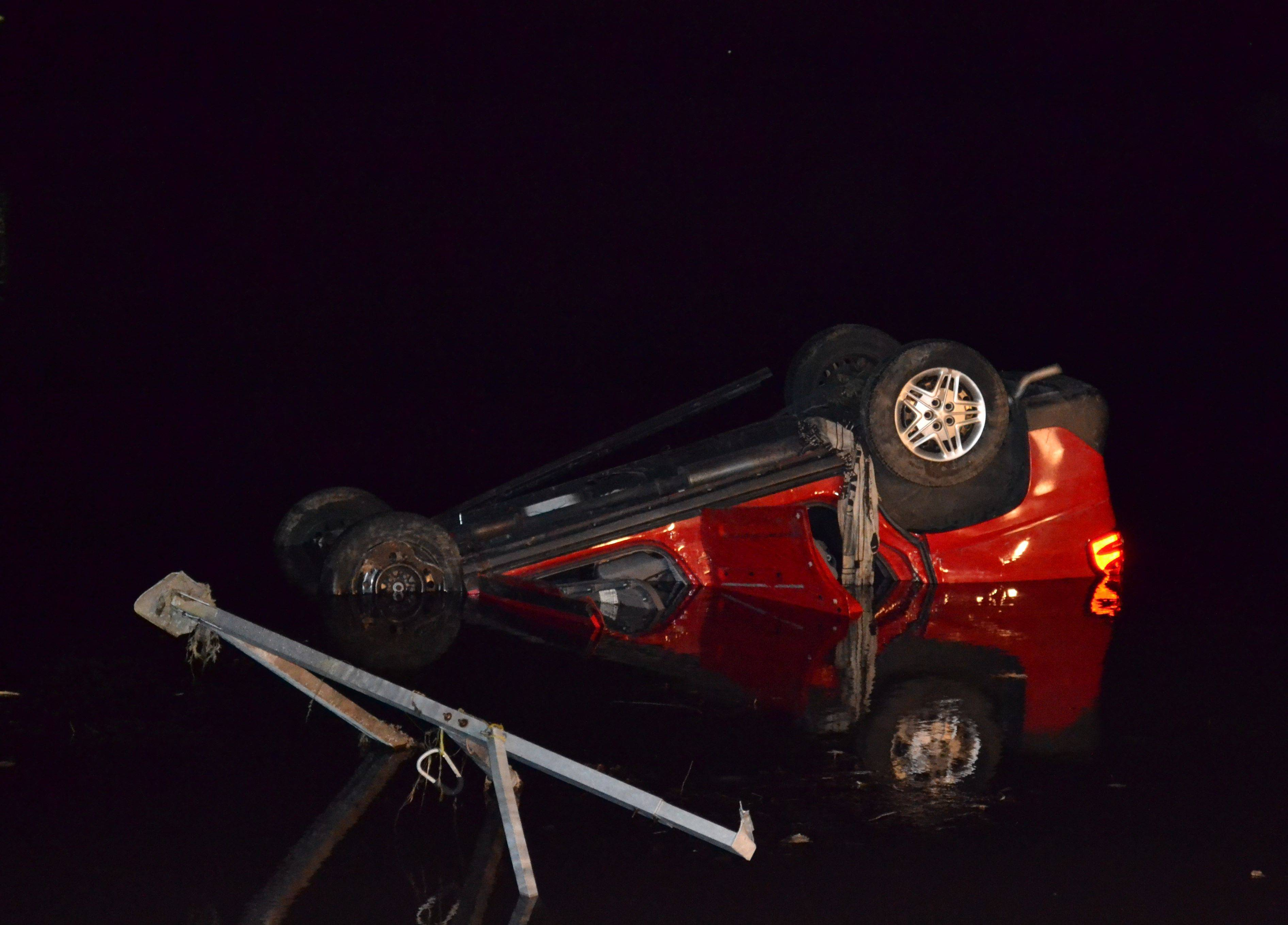 A Pontiac Aztek SUV left the road early Friday and ended up 50 feet into Lake Miltmore, from which the vehicle was pulled overnight. The driver drowned, but a passenger survived.