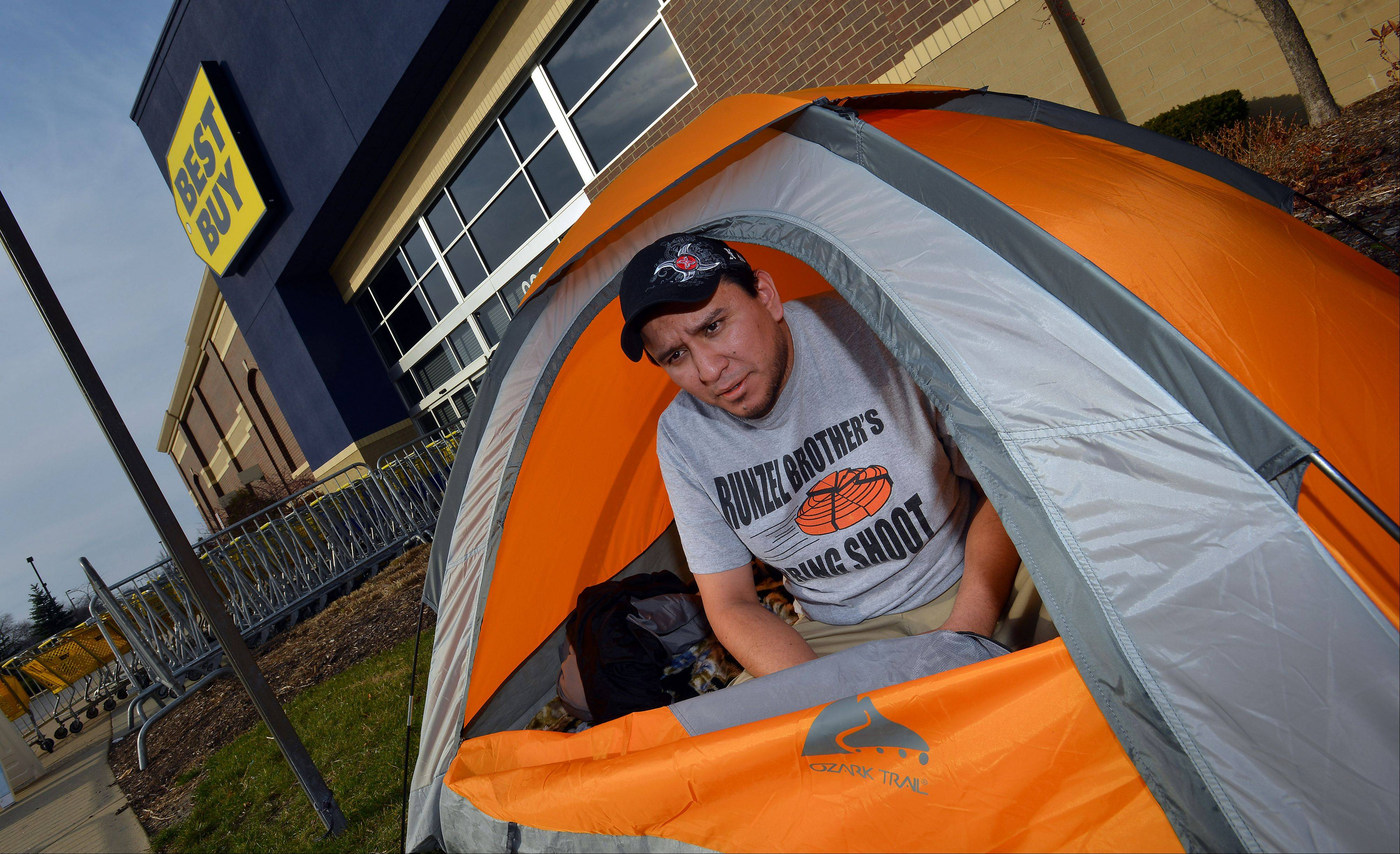 Tent city in front of the Best Buy in Schaumburg popped up at 12 a.m. on Tuesday with Felipe Acosta, 33, of Mt. Prospect driving the first tent stake looking for Black Friday deals skipping his Thanksgiving dinner.