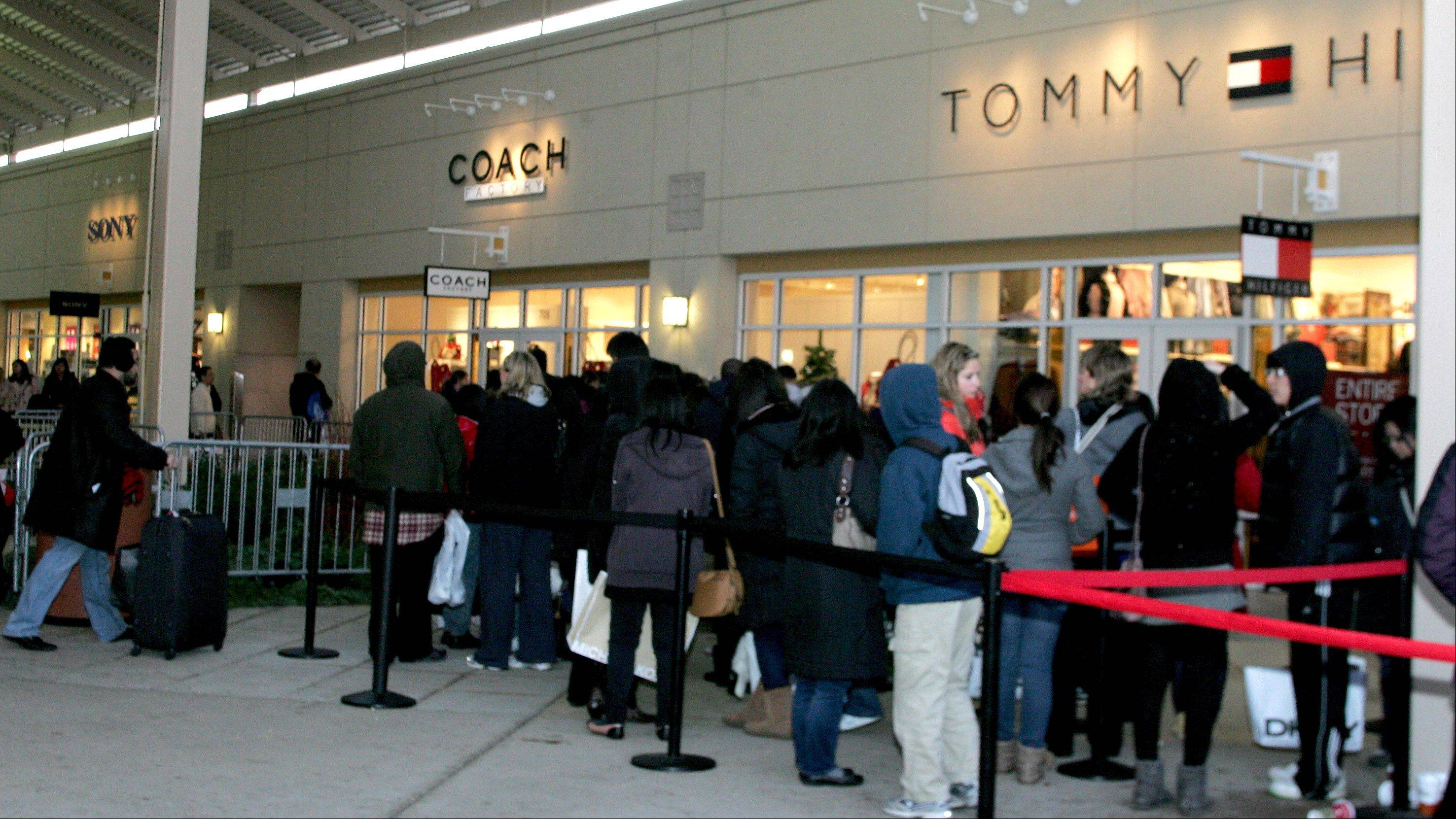 Black Friday customers lined up to get in the Coach store last year at Chicago Premium Outlets in Aurora.