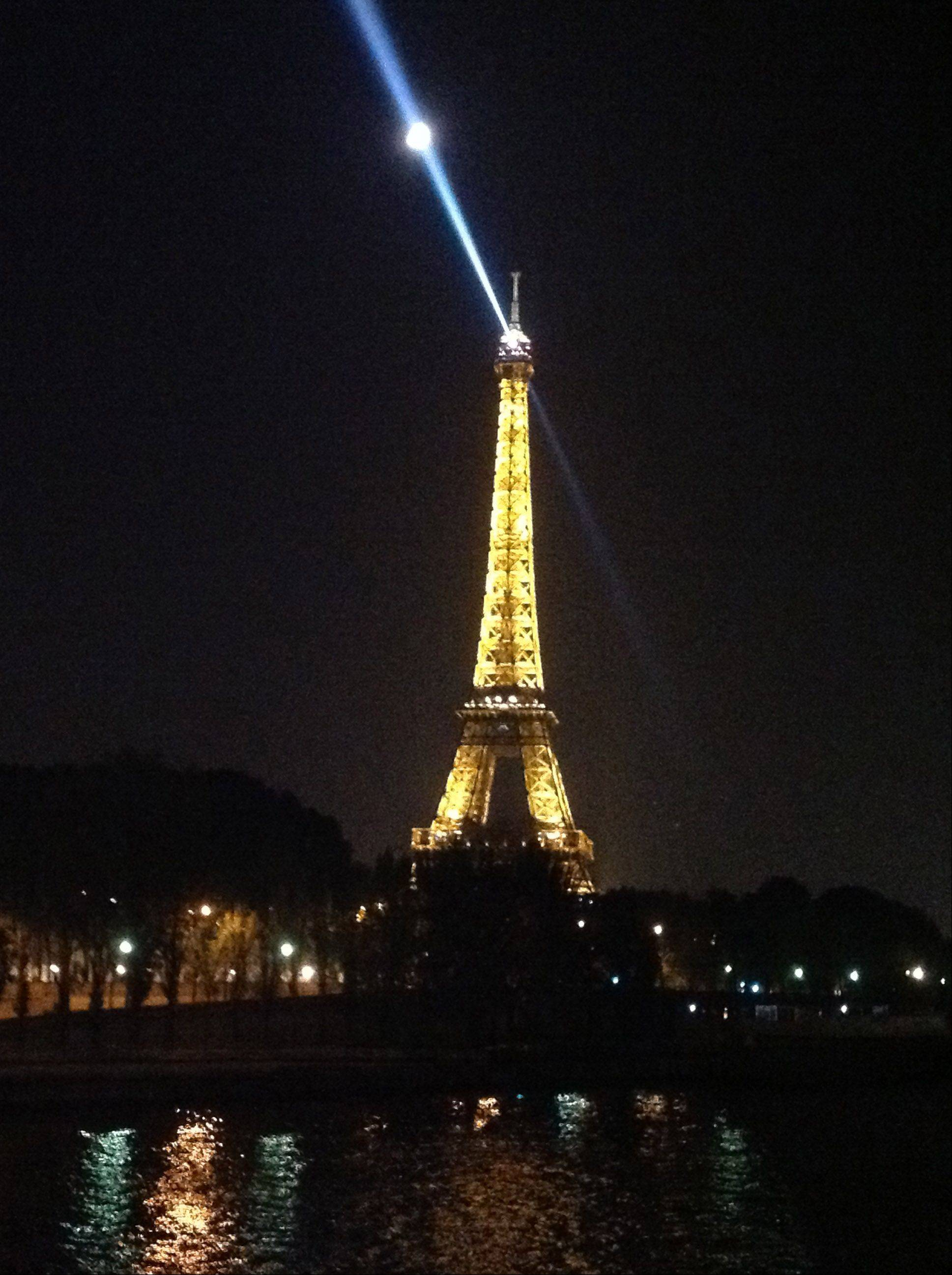 A light shines at midnight from the Eiffel Tower in Paris on October 23rd.
