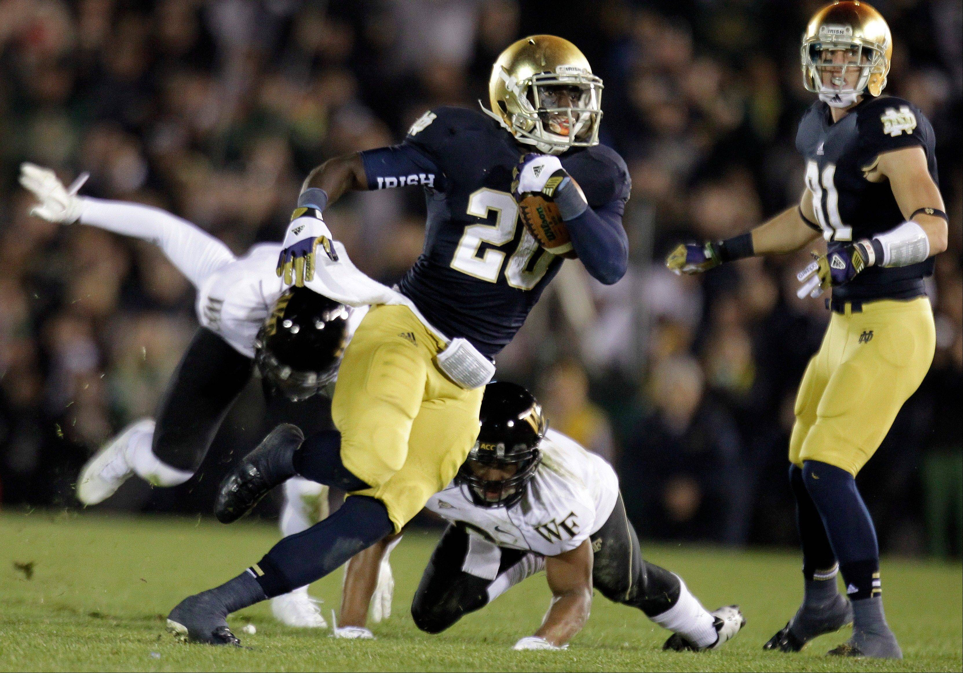 Notre Dame running back Cierre Wood (20) and his Fighting Irish teammates are just one win away from playing for the national title.