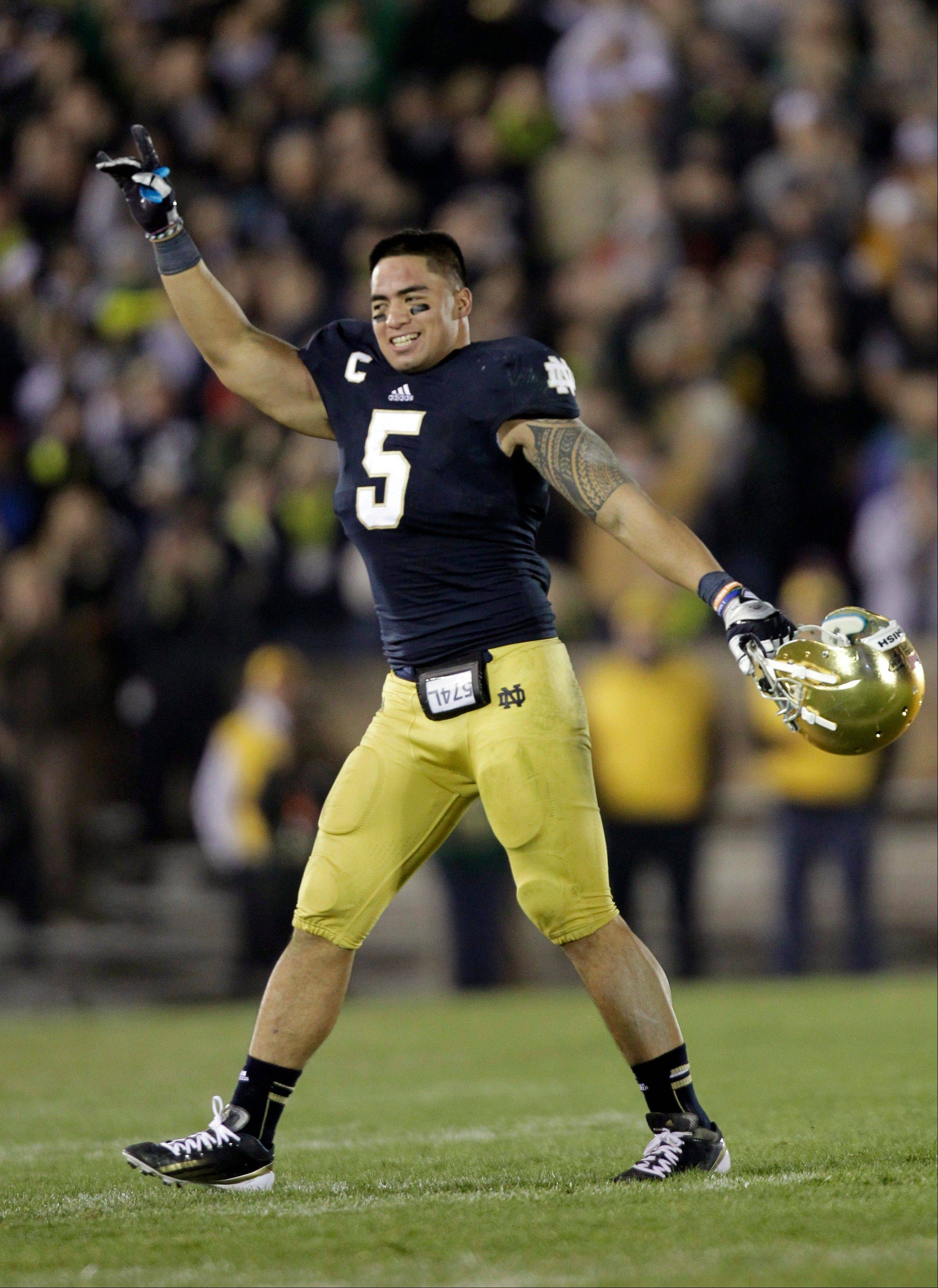 Notre Dame linebacker Manti Te'o acknowledges the applause of fans as he leaves his final home game late in the fourth quarter against Wake Forest game.