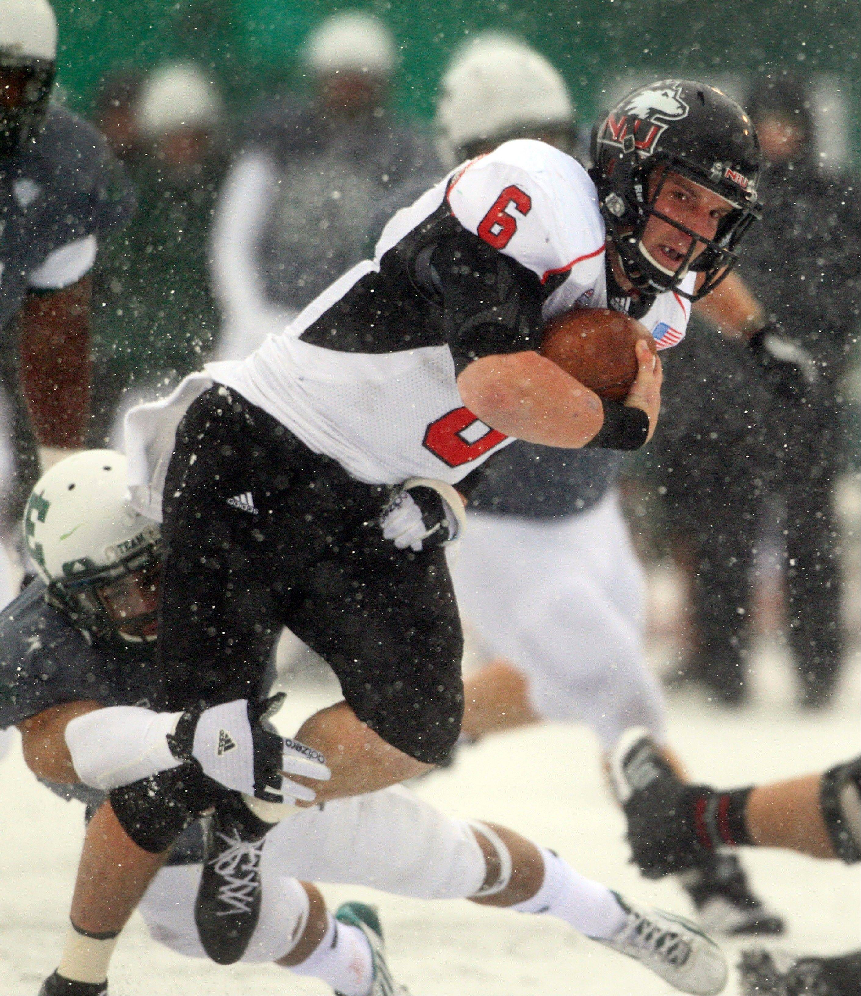 Northern Illinois Huskies quarterback Jordan Lynch is stopped on a run by Eastern Michigan Friday during the second quarter in Ypsilanti, Mich. The Huskies beat Eastern Michigan 49-7.