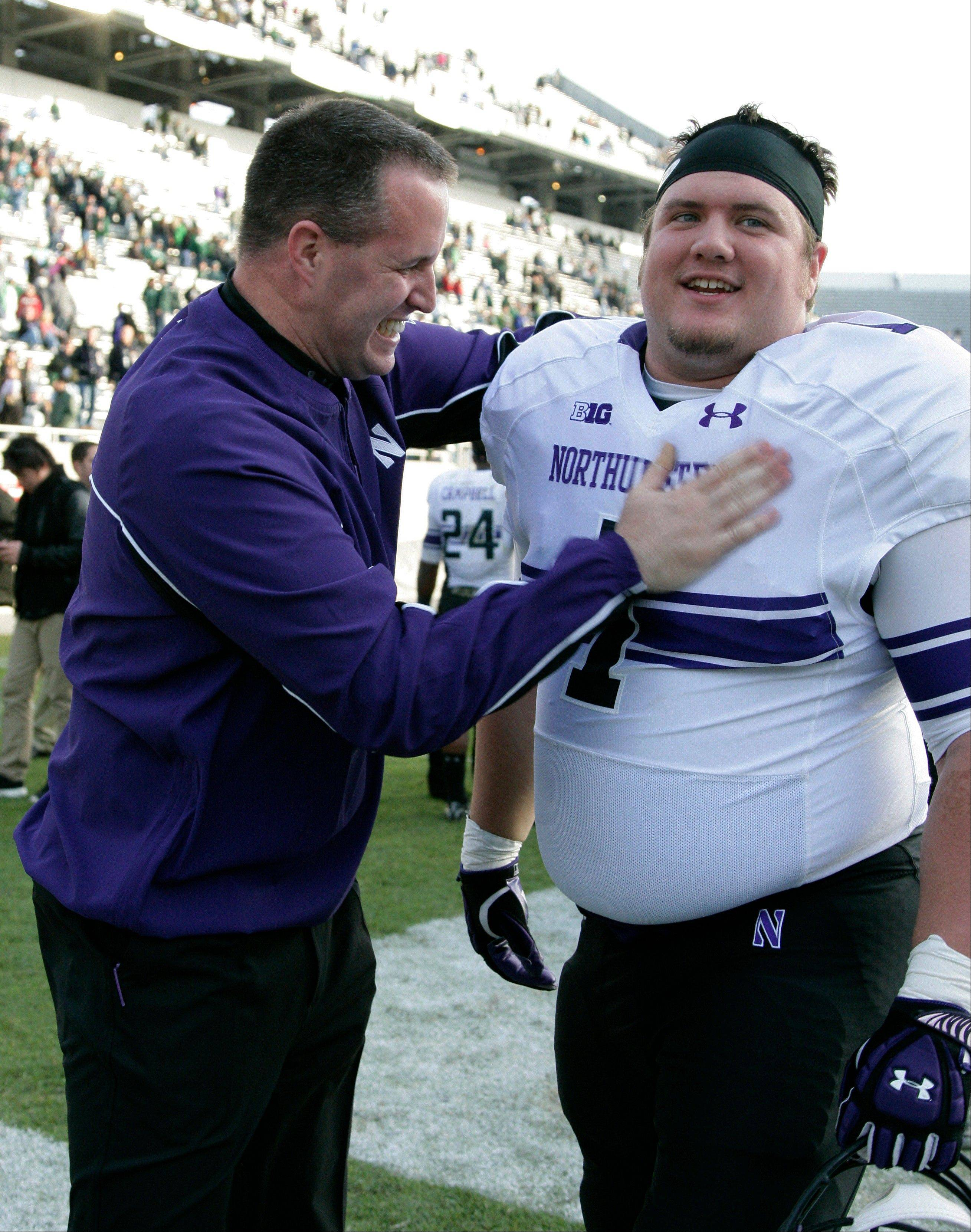Northwestern coach Pat Fitzgerald celebrates with Bo Cisek following a 23-20 win over Michigan State in East Lansing, Mich.