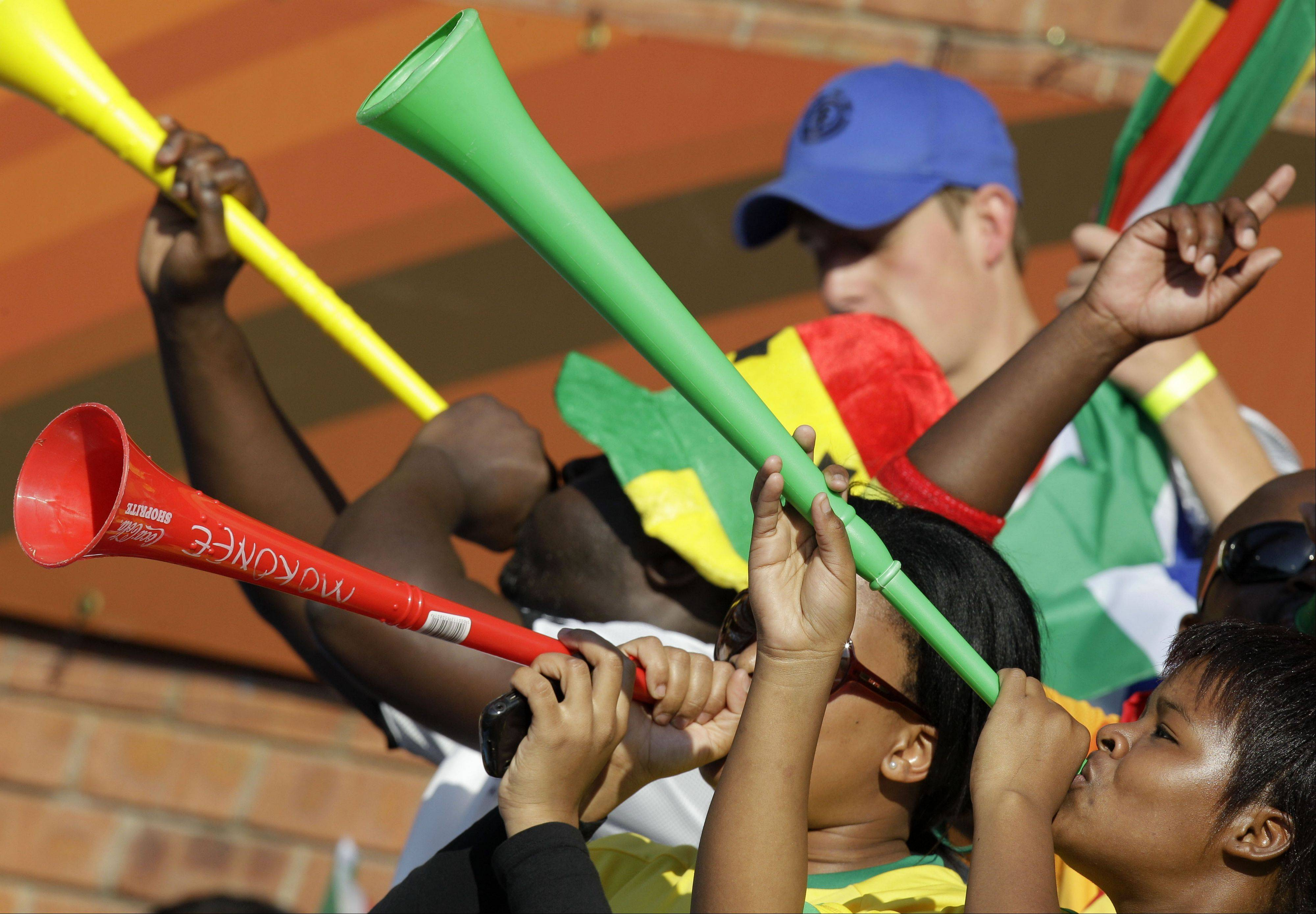 Fans play their vuvuzelas before a World Cup group match in Pretoria, South Africa, on June 13, 2010. A report now says the South African government spent more than $3 billion to host the tournament, including $1.1 billion on stadiums.