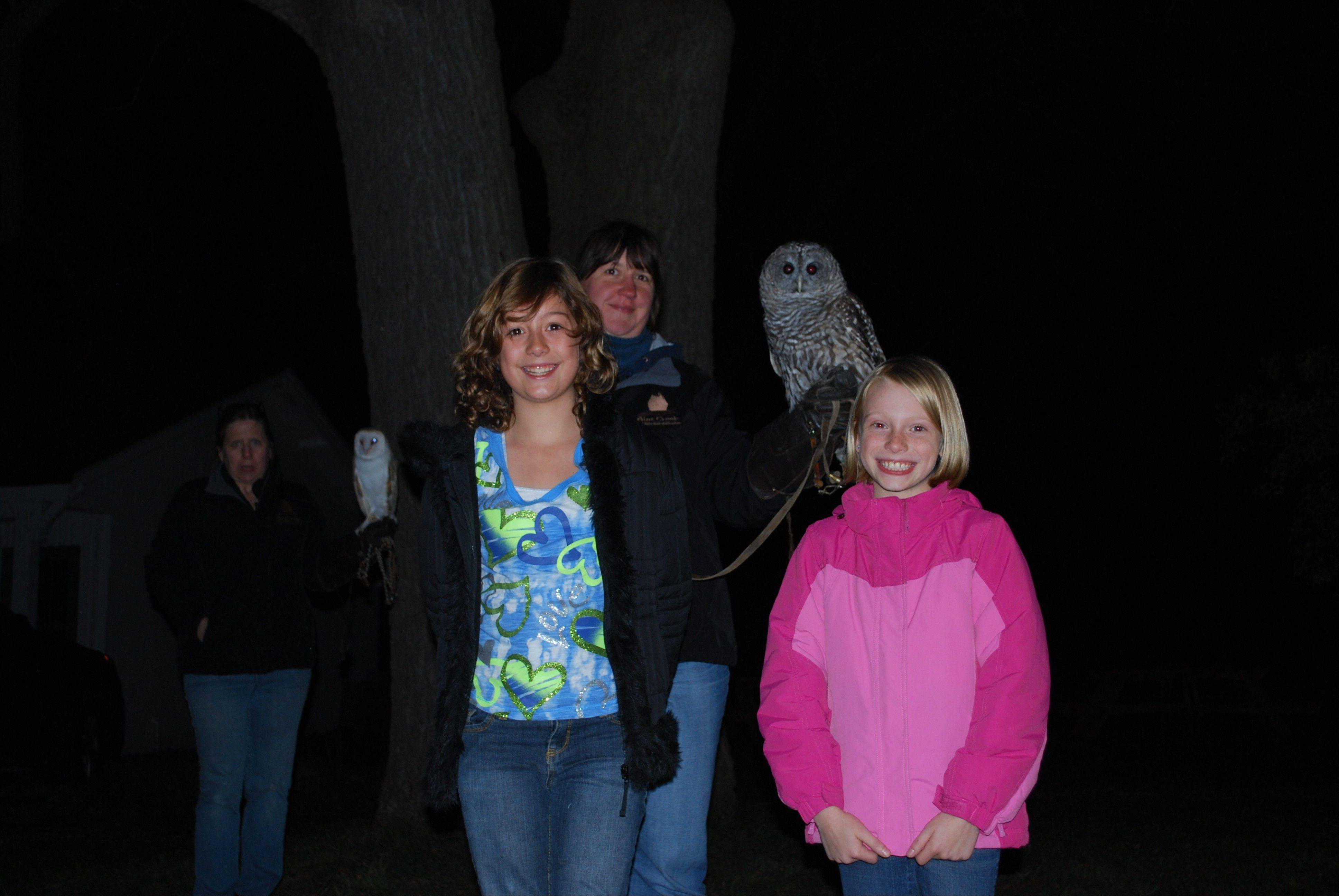 Citizens for Conservation's Owl Prowl class participants with Meepy the barred owl.