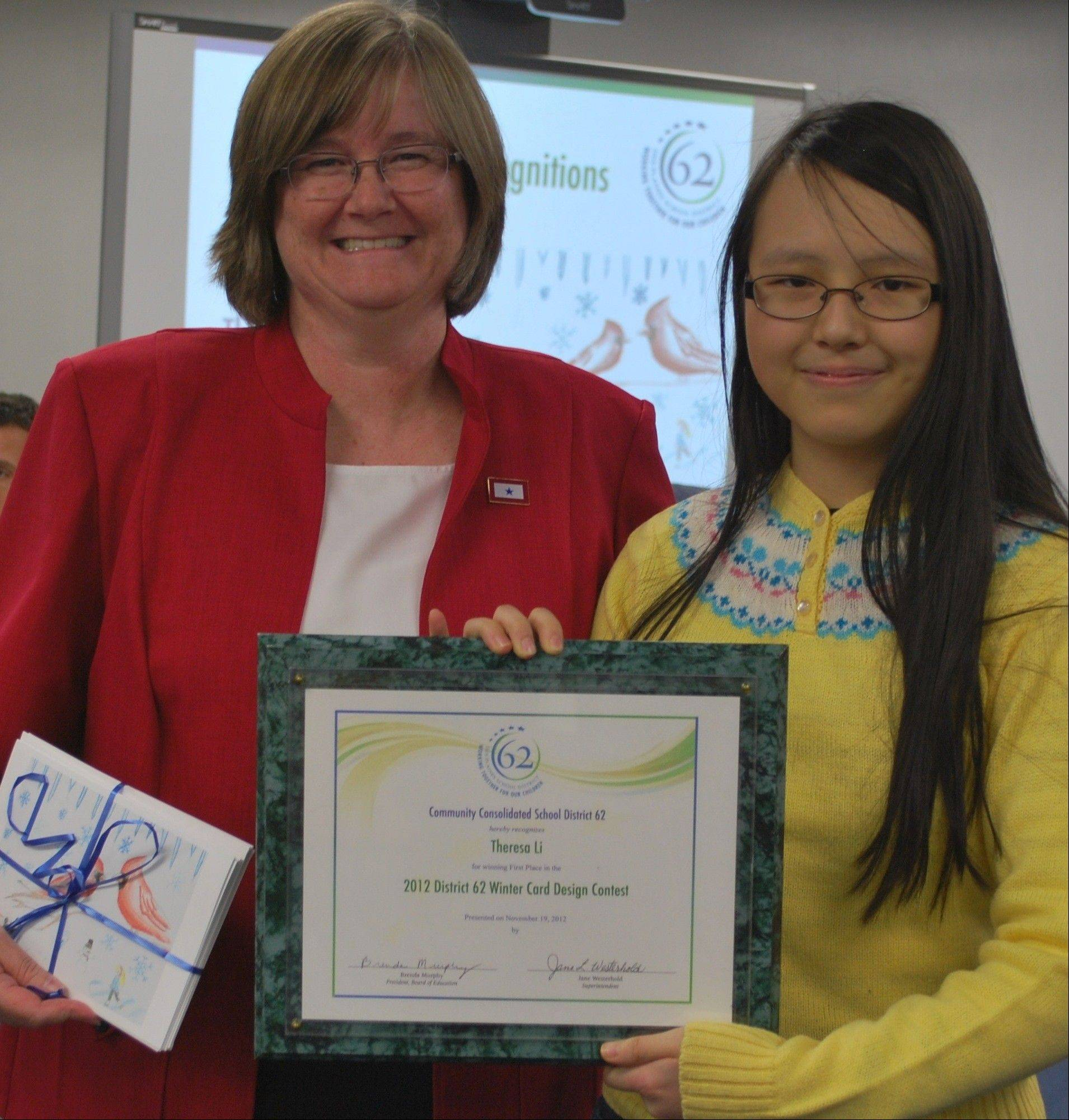 District 62 School Board President Brenda Murphy awards Algonquin Middle School student Theresa Li first place in the 2012 District 62 Winter Card Design Contest.