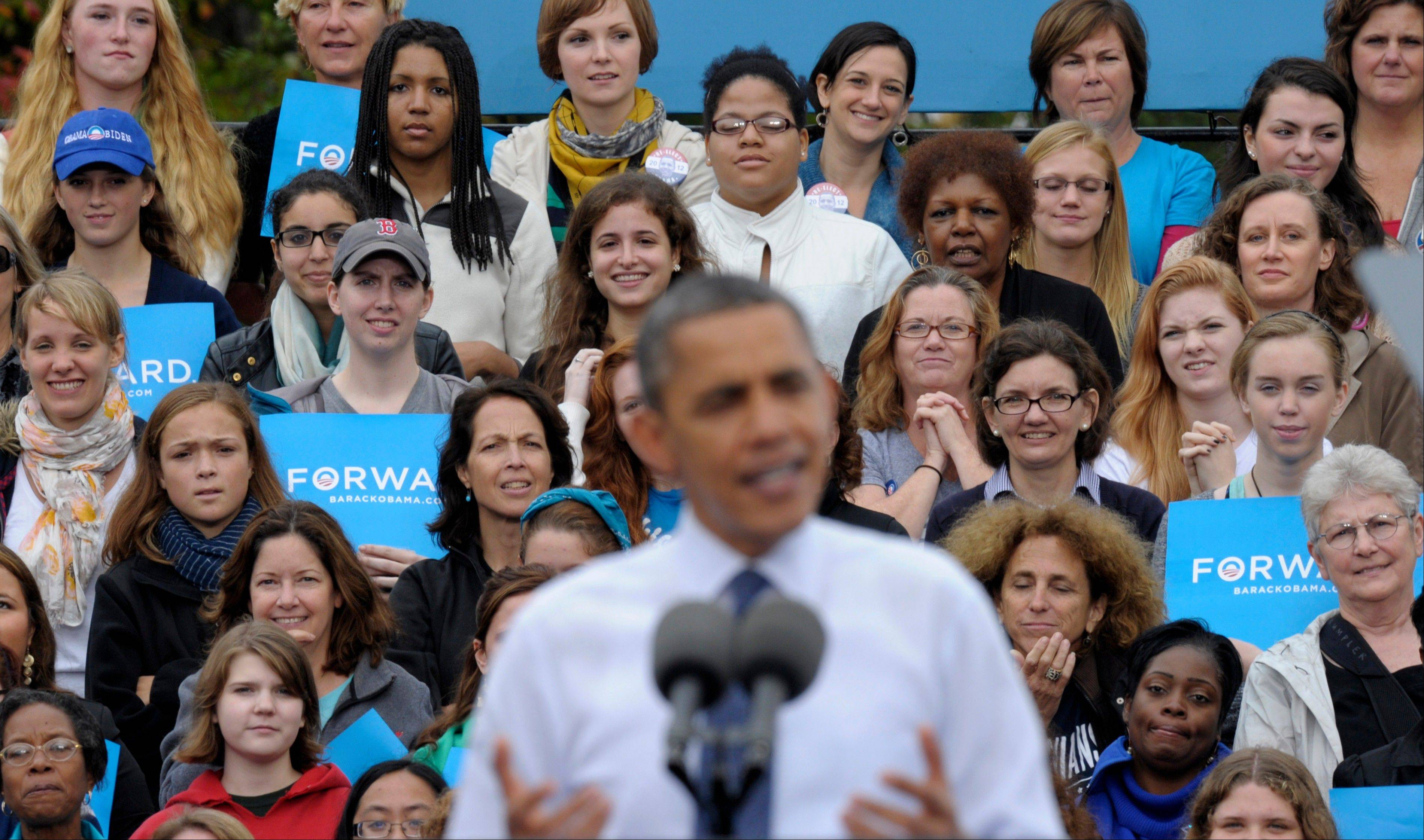 Associated Press/Oct. 19, 2012 A mostly women audience listens behind President Barack Obama as he speaks about the choices facing them in the election, during a campaign event at George Mason University in Fairfax, Va. More women voted for Obama, more men for Romney.