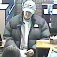 Surveillance footage captured a man robbing Glenview State Bank in Arlington Heights on Friday morning. The same man is suspected of robbing a Rolling Meadows bank in October.
