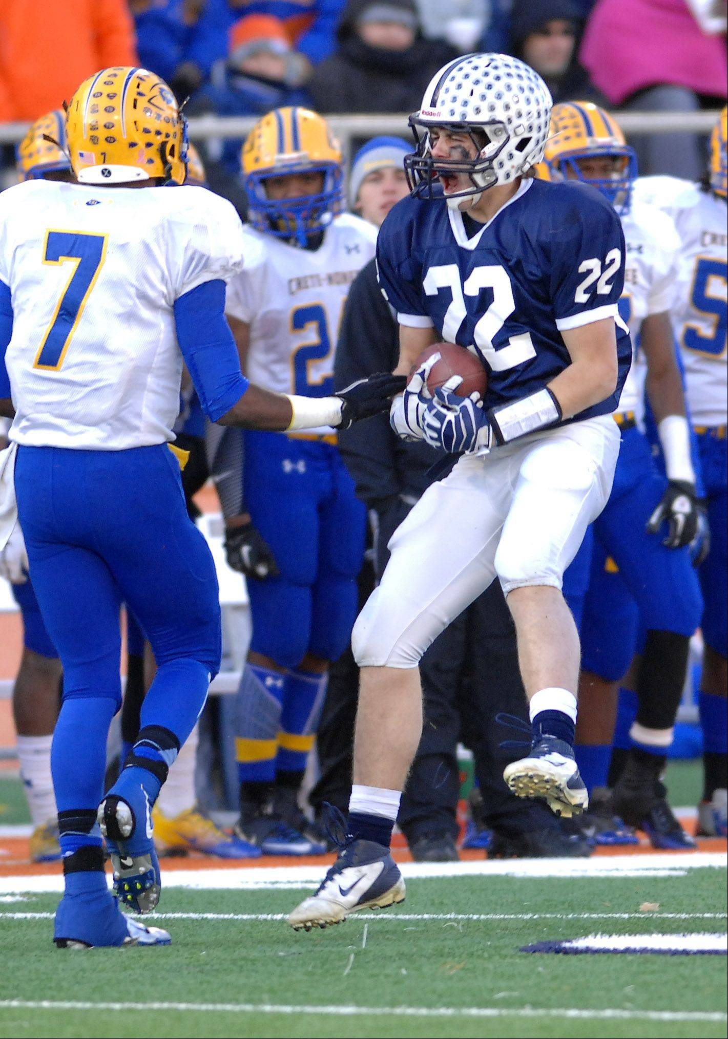 Cary-Grove�s Kasey Fields (22) celebrates an interception during Saturday�s Class 6A state title game at Memorial Stadium in Champaign.