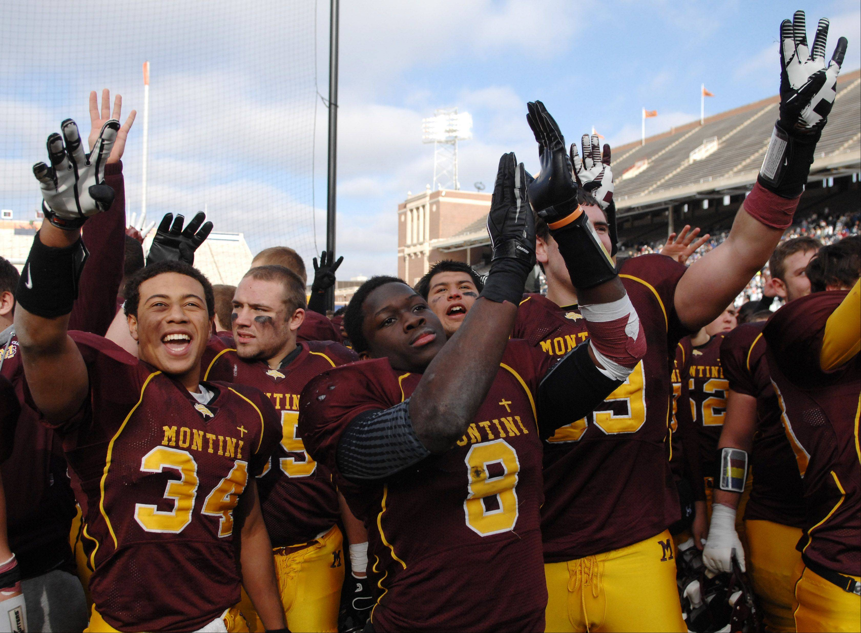Montini players salute their fans after their win over Morris during Saturday�s Class 5A state title game at Memorial Stadium in Champaign.