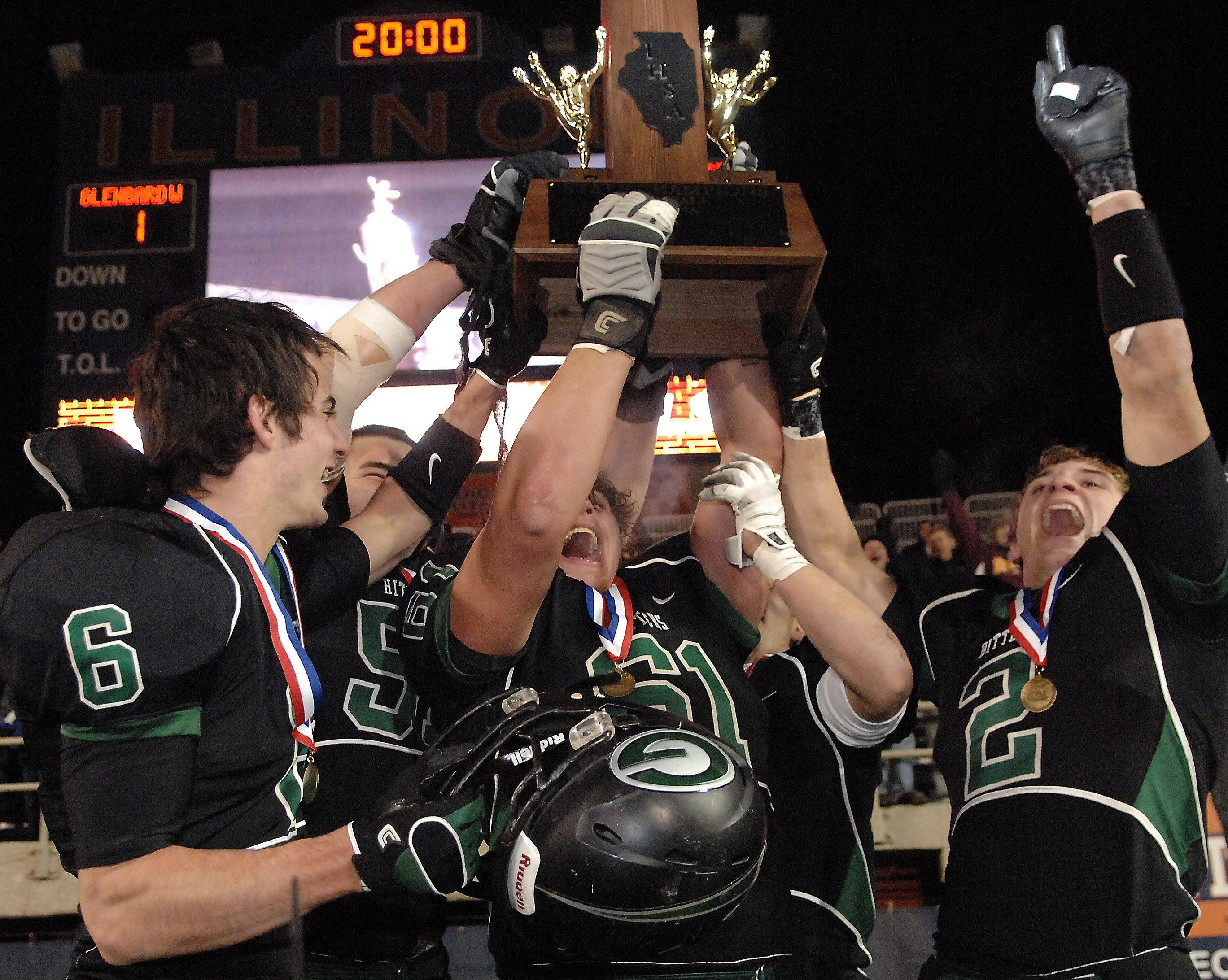 The Glenbard West captains hoist the championship trophy following their win over Lincoln-Way East during Saturday�s Class 7A state title game at Memorial Stadium in Champaign.