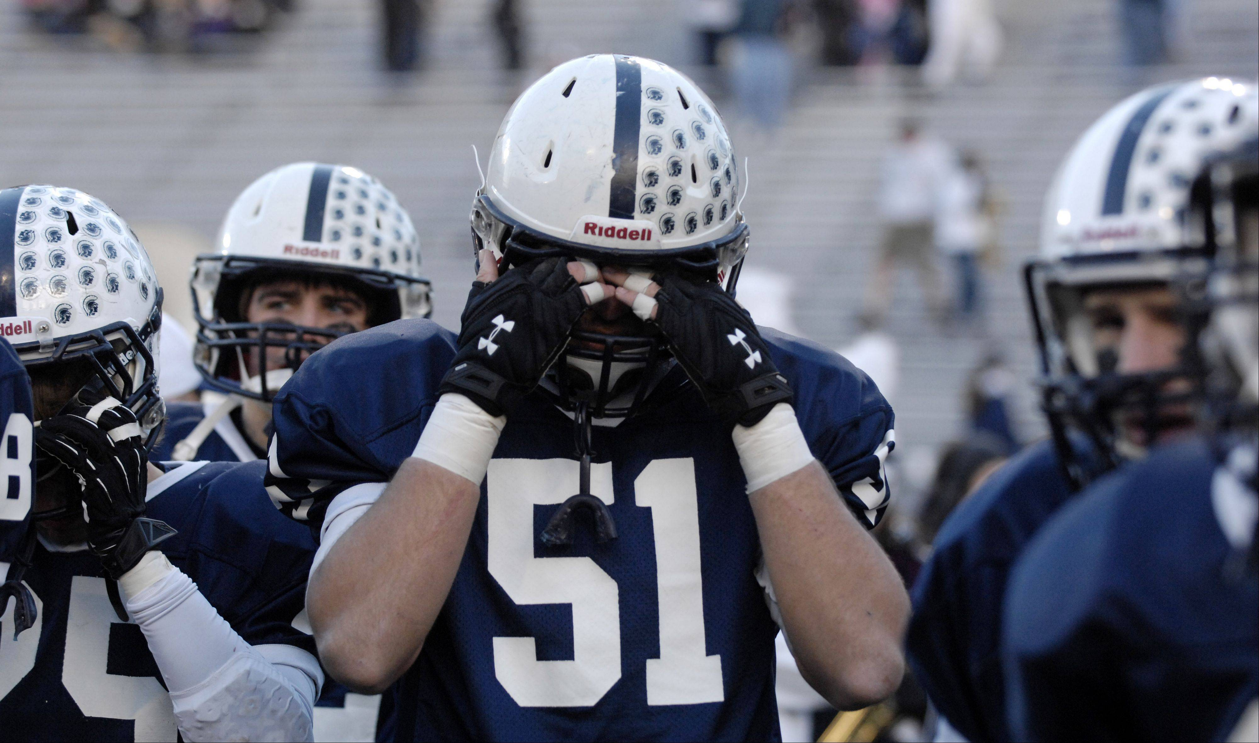 Cary-Grove�s Kyle Matthiesen (51) and his teammates react to their 33-26 loss to Crete-Monee in Saturday�s Class 6A state title game at Memorial Stadium in Champaign.