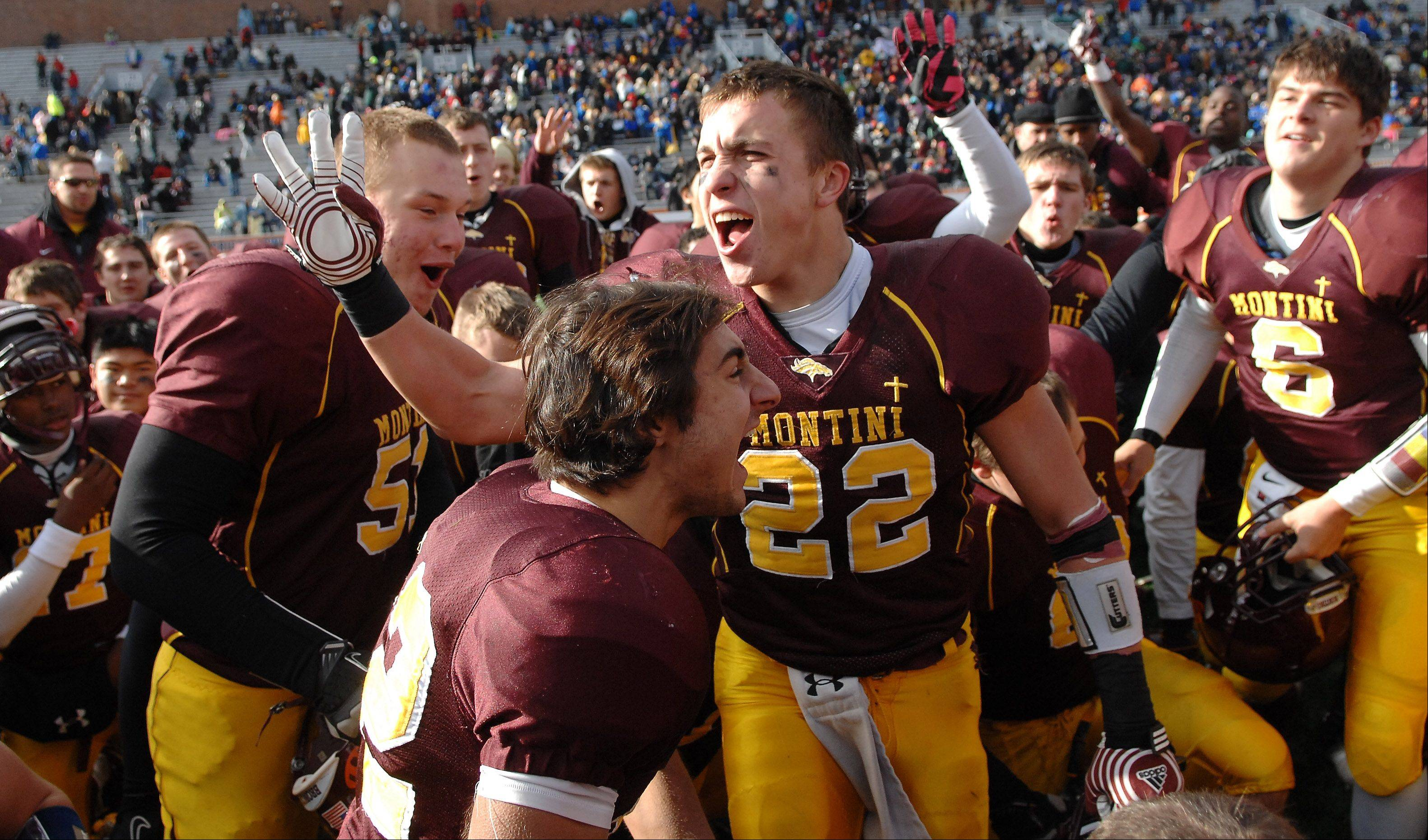 Montini�s Ryan Starbeck (22) and his teammates celebrate after their win over Morris during Saturday�s Class 5A state title game at Memorial Stadium in Champaign.