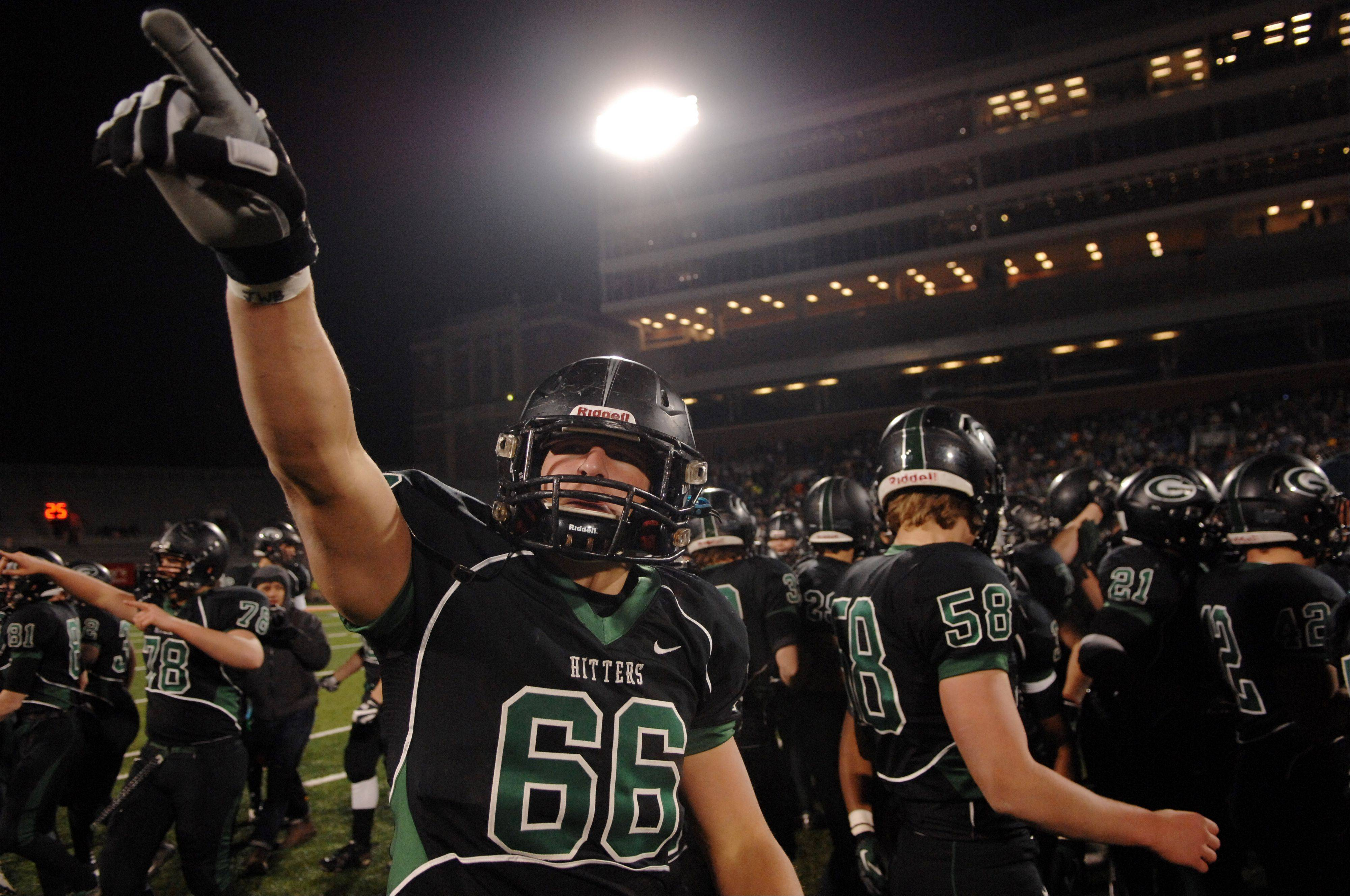 Glenbard West offensive linesman Max Bruere (66) salutes the crowd as he and the Hilltoppers celebrate their win over Lincoln-Way East during Saturday�s Class 7A state title game at Memorial Stadium in Champaign.