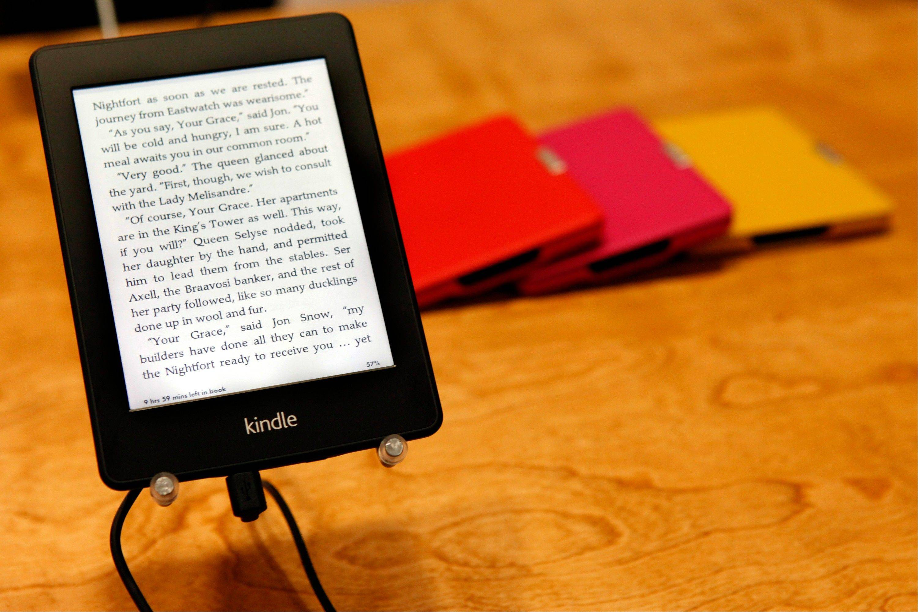 Amazon.com, Inc.'s Kindle Paperwhite tablet sits on display after a news conference in Santa M
