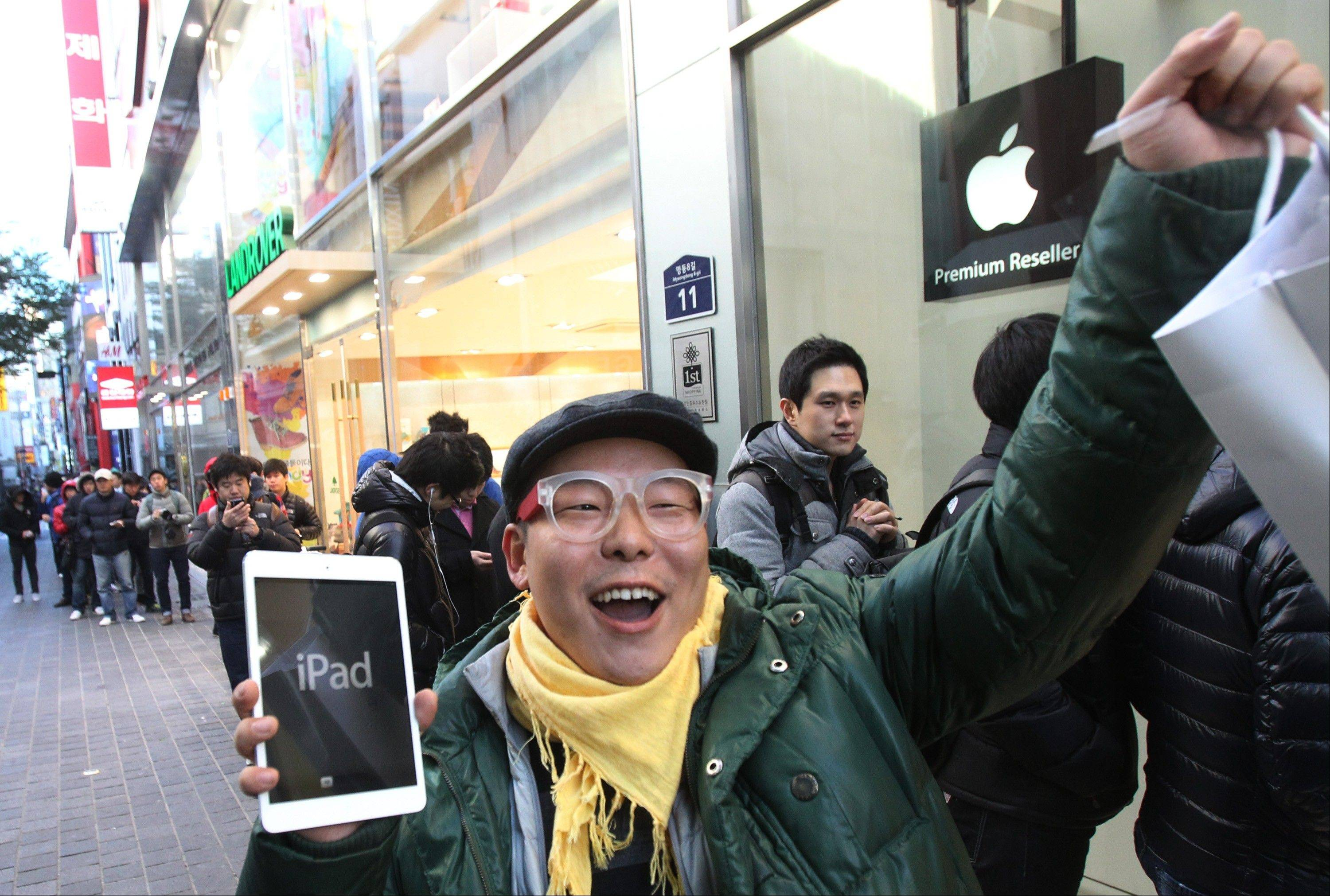Song Tae-min reacts after buying a new iPad Mini in Seoul, South Korea. The tablet computer is without a doubt the gift of the year, just like it was last year. But if you resisted the urge in 2011, now is the time to give in. This season's tablets are better all around. Intense competition has kept prices very low, making tablets incredible values compared to smartphones and PCs.