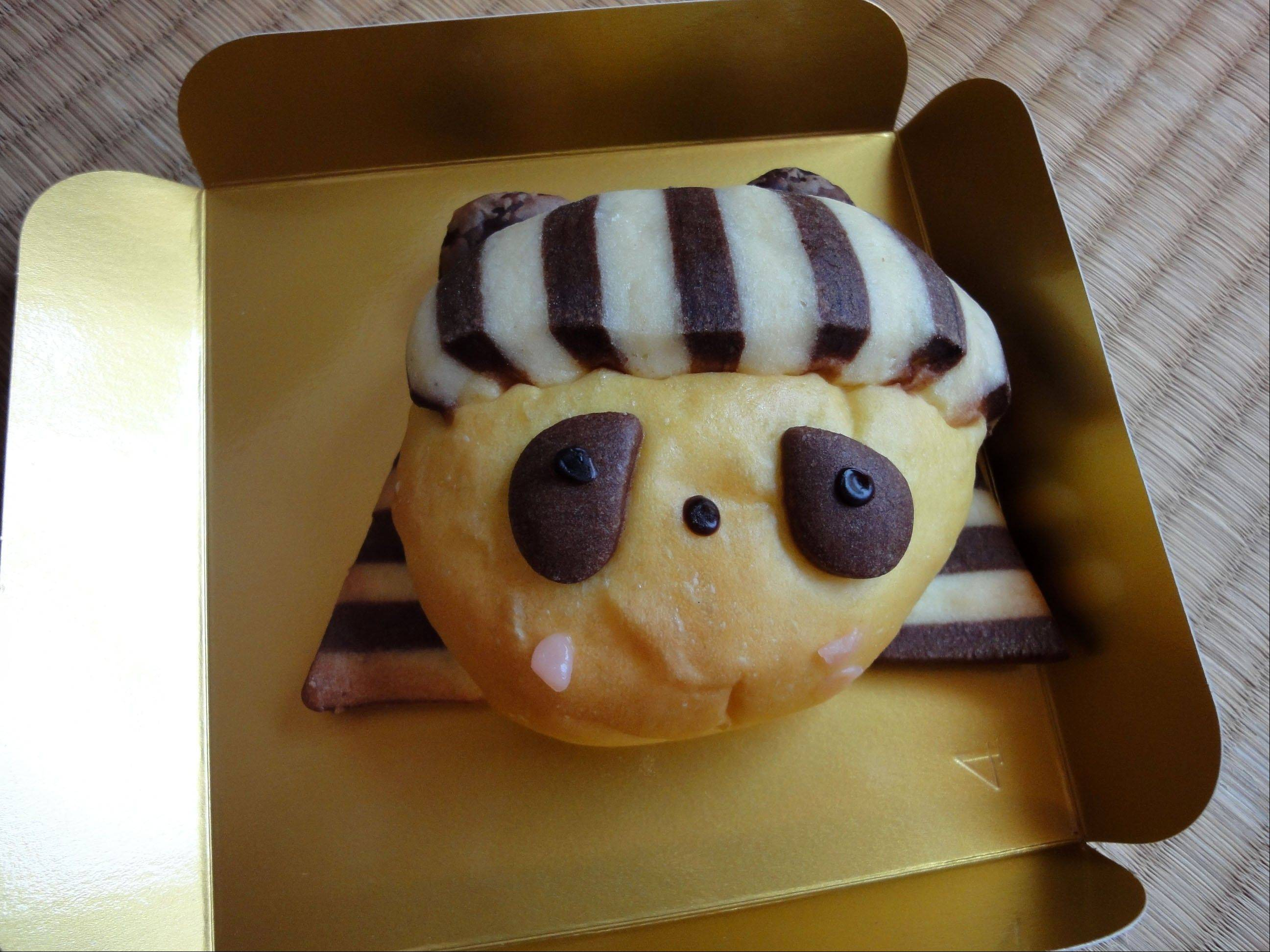 A bun sold at a bakery in Tokyo's Ueno train station is designed like a panda in honor of the panda at Tokyo's Ueno Zoo.