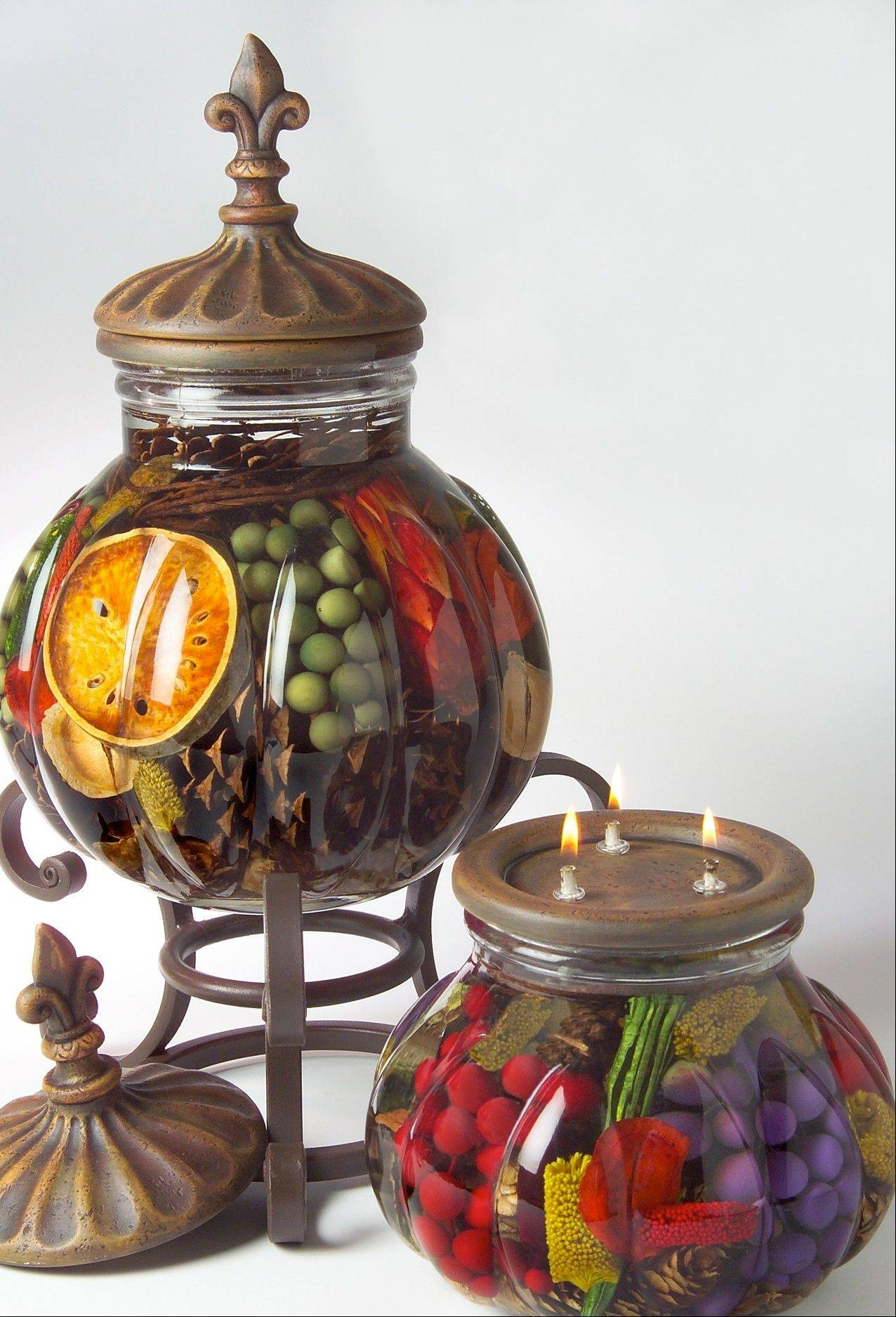 Lifetime candles are actually clear paraffin oil lamps filled with decorative flowers, berries, greens, fruits or vegetables.