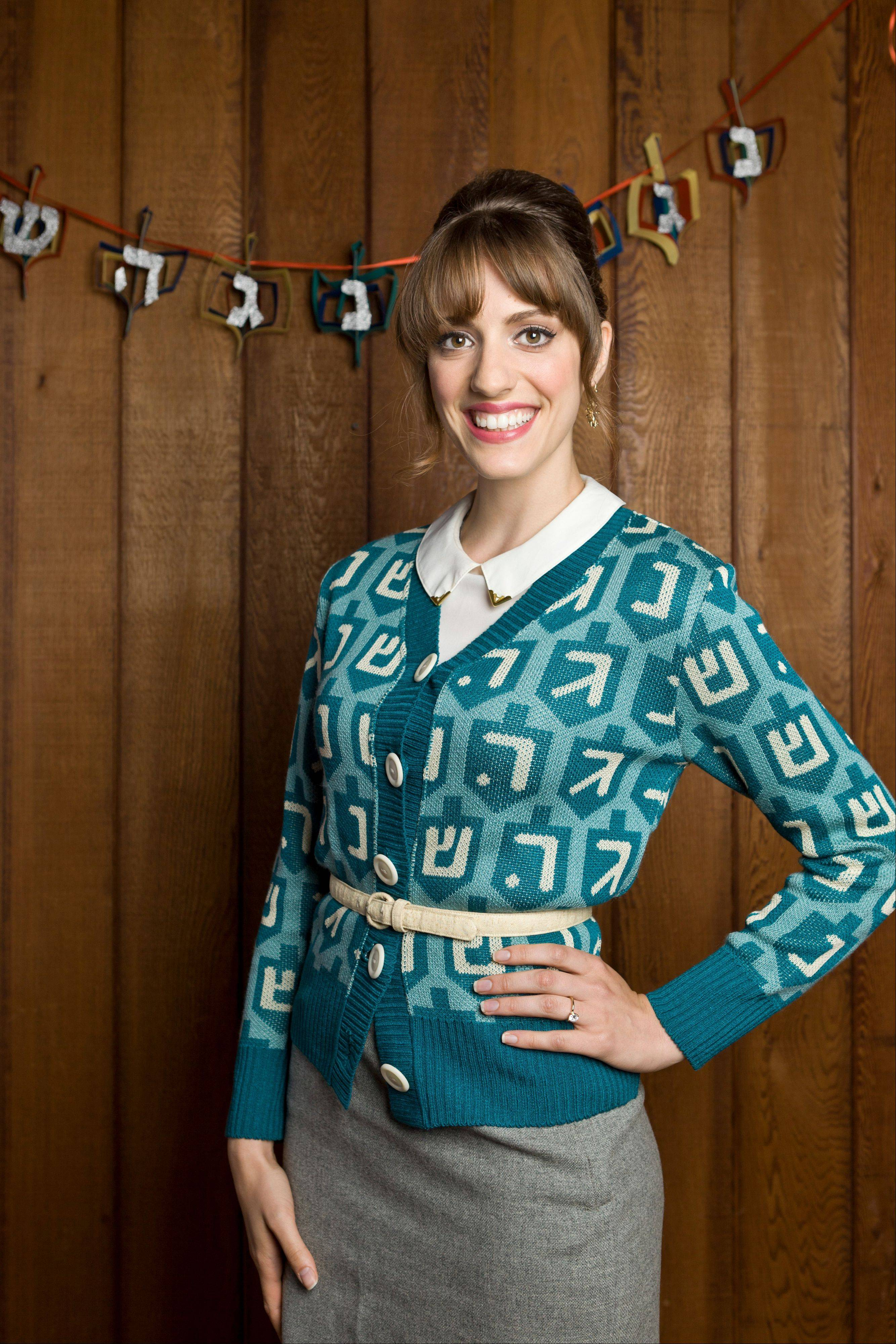 A holiday sweater decorated in a dradle print.