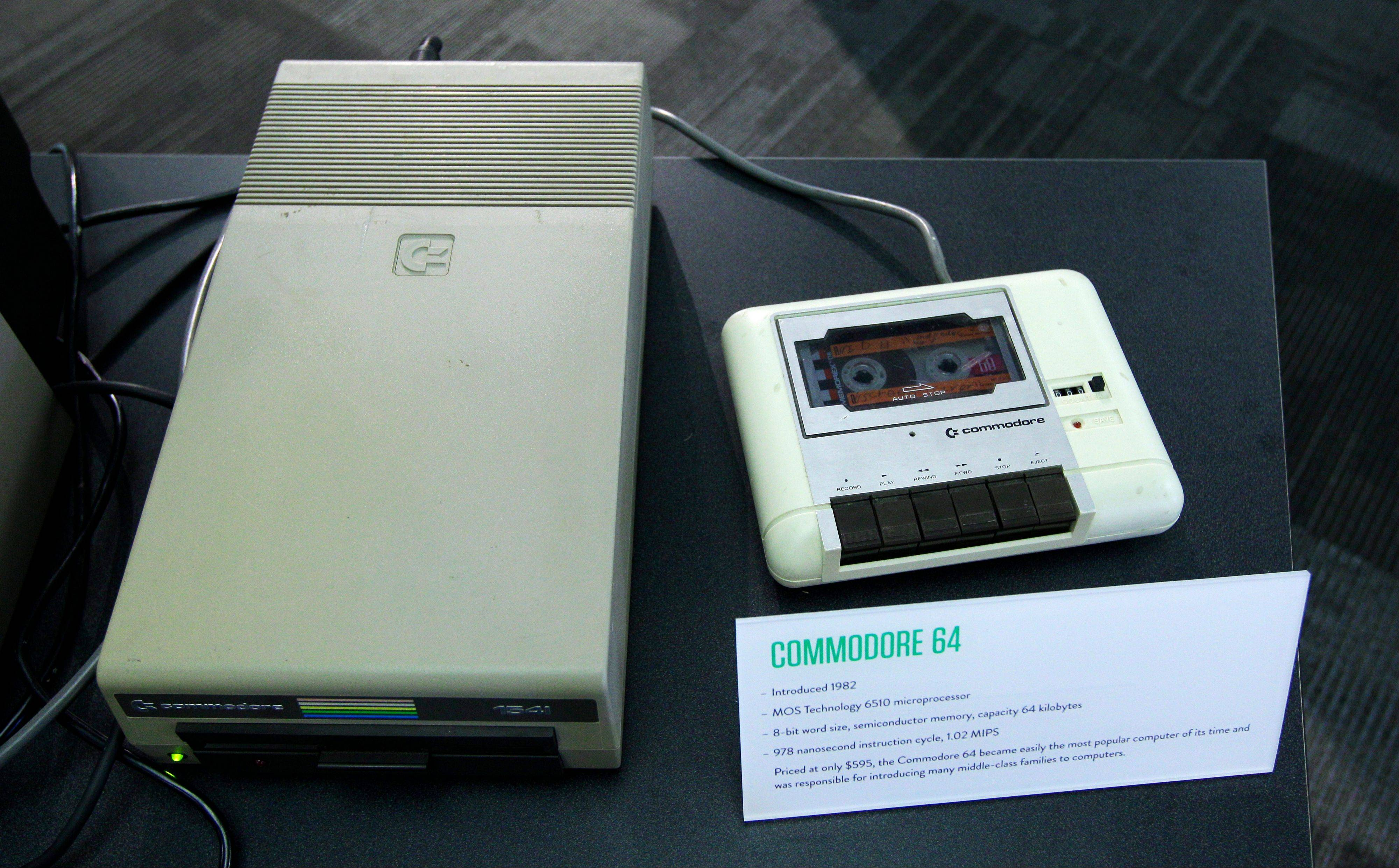 A floppy disk drive, left, and a cassette tape data drive for a Commodore 64 personal computer are on display at the Living Computer Museum in Seattle openedy by Microsoft co-founder Paul Allen.