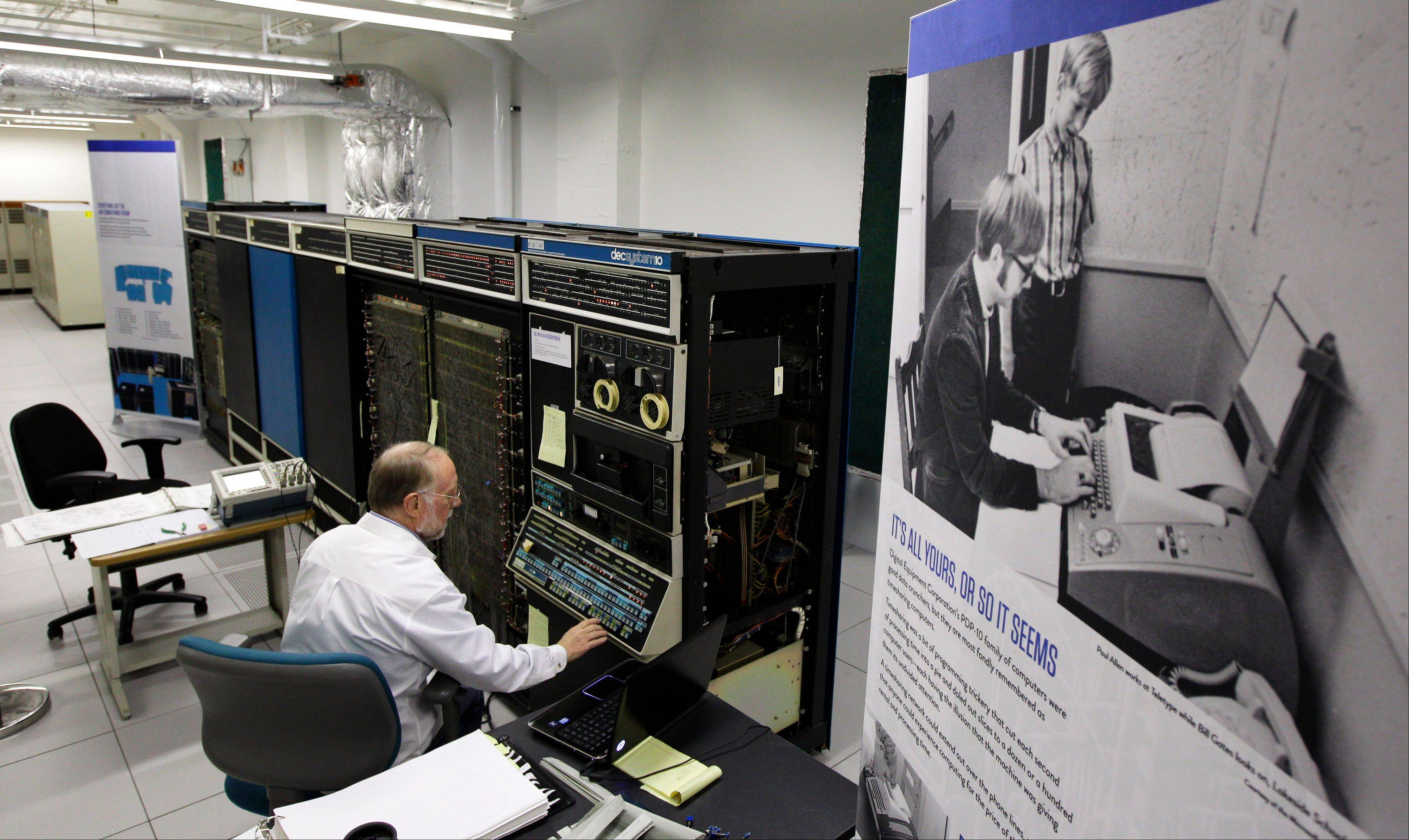 Bruce Sherry, a contract engineer at the Living Computer Museum in Seattle, manually programs a DEC PDP-10 computer from the early 1970s.