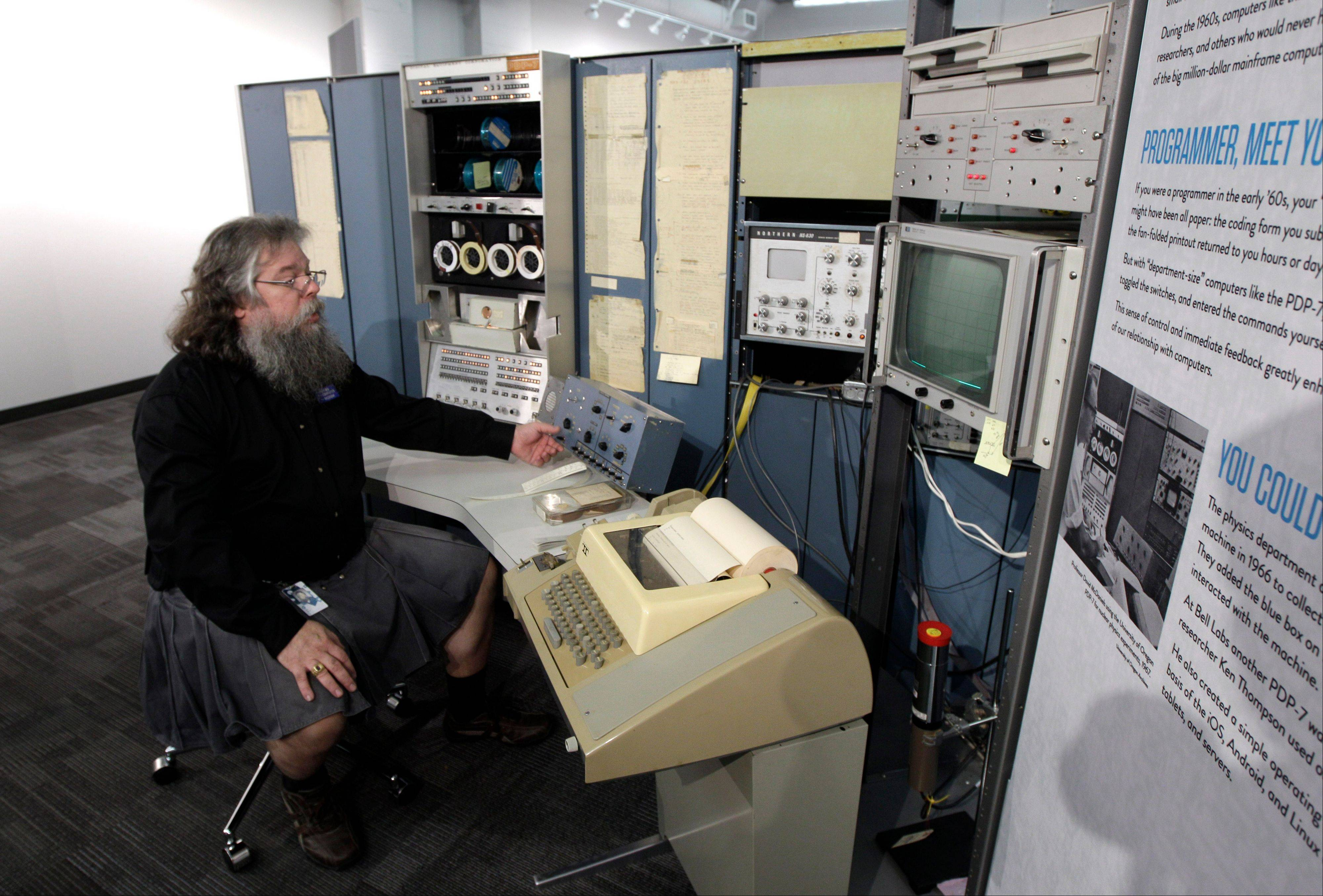 Ian King, senior vintage systems engineer at the Living Computer Museum in Seattle, sits at the controls of a DEC PDP-7 computer from the mid 1960s, one of the oldest running computers at the newly opened Living Computer Museum.
