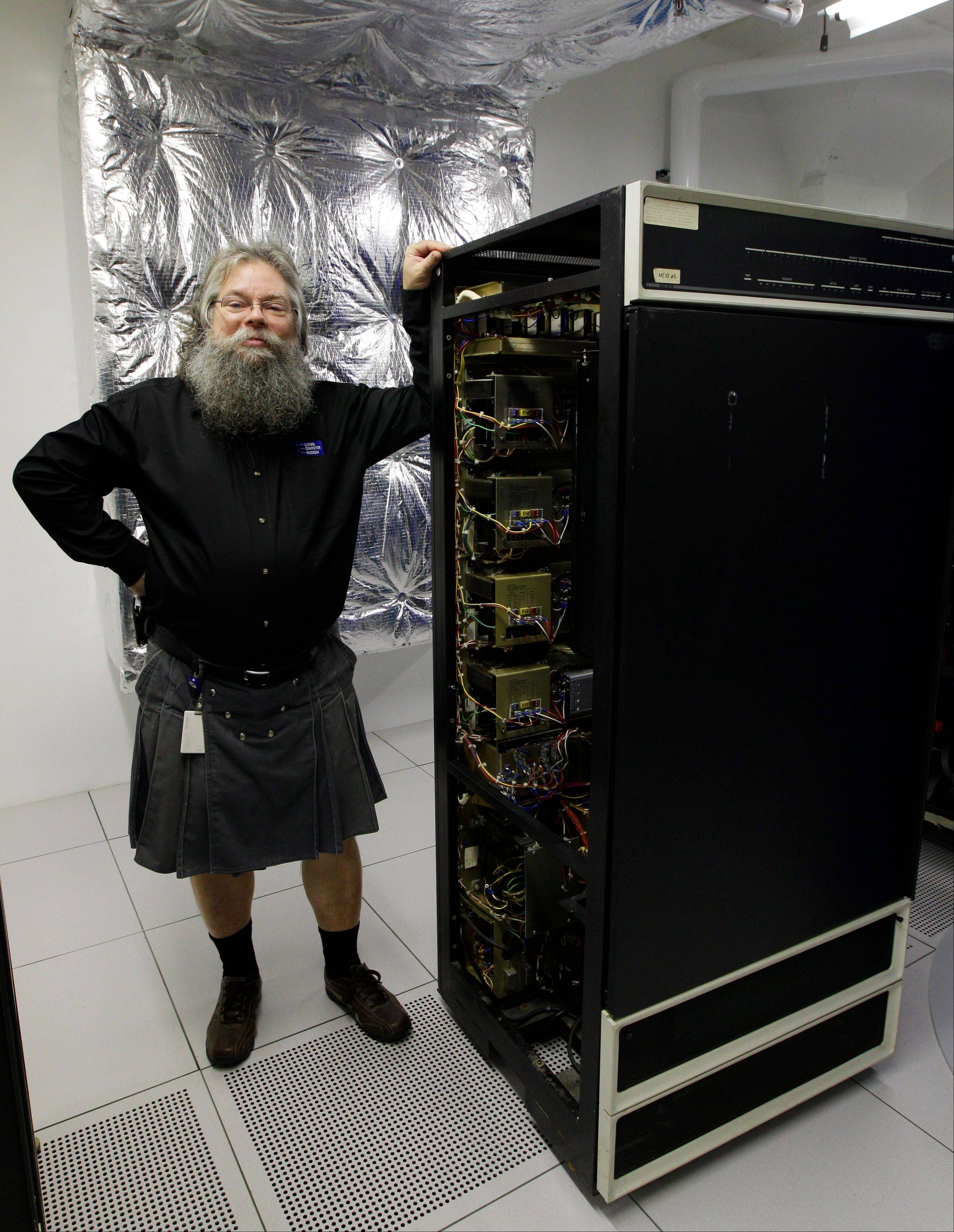 In the Living Computer Museum, Ian King shows off a memory module of a DEC PDP-10 computer that holds 16 kilobytes of computer memory.