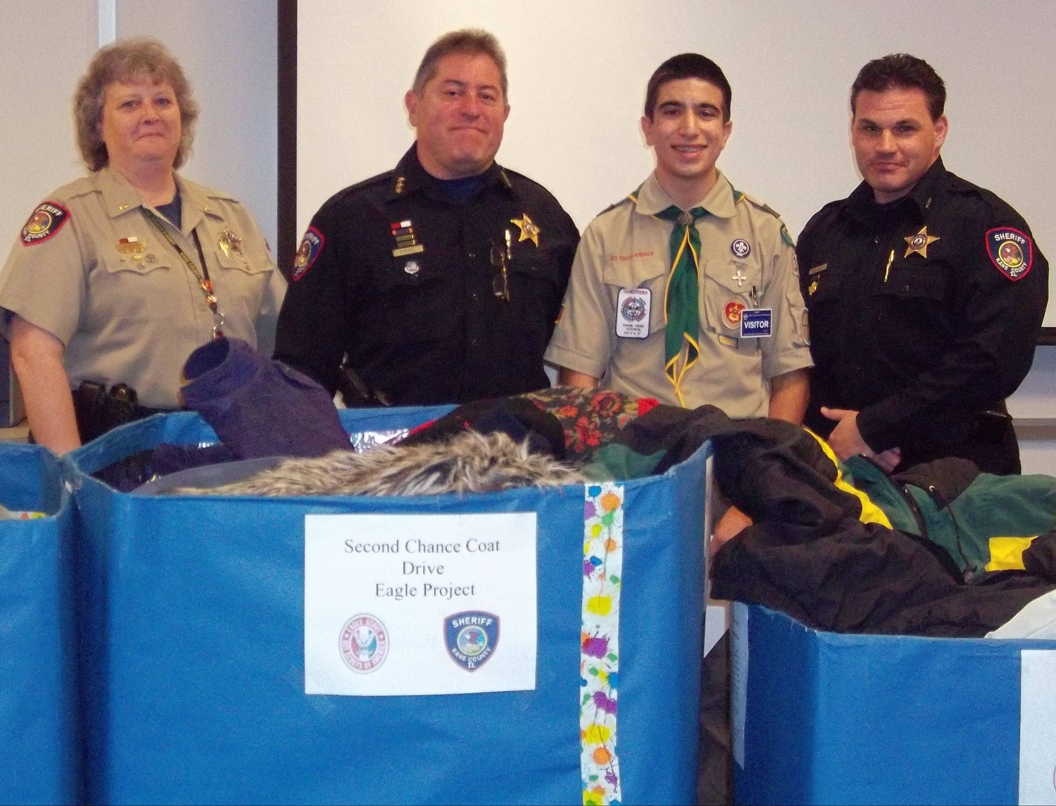 "From left, Kane County Corrections Lt. Lynne Woodruff, Sheriff Pat Perez, Eagle Scout candidate Ted Spiro and Undersheriff David Wagner thanked Spiro for his successful ""Second Chance Coat Drive,"" which resulted in 300 winter coats for inmates at the Kane County jail. Spiro, of Geneva, went to more than 1,500 homes throughout the Tri-Cities to solicit the coats."