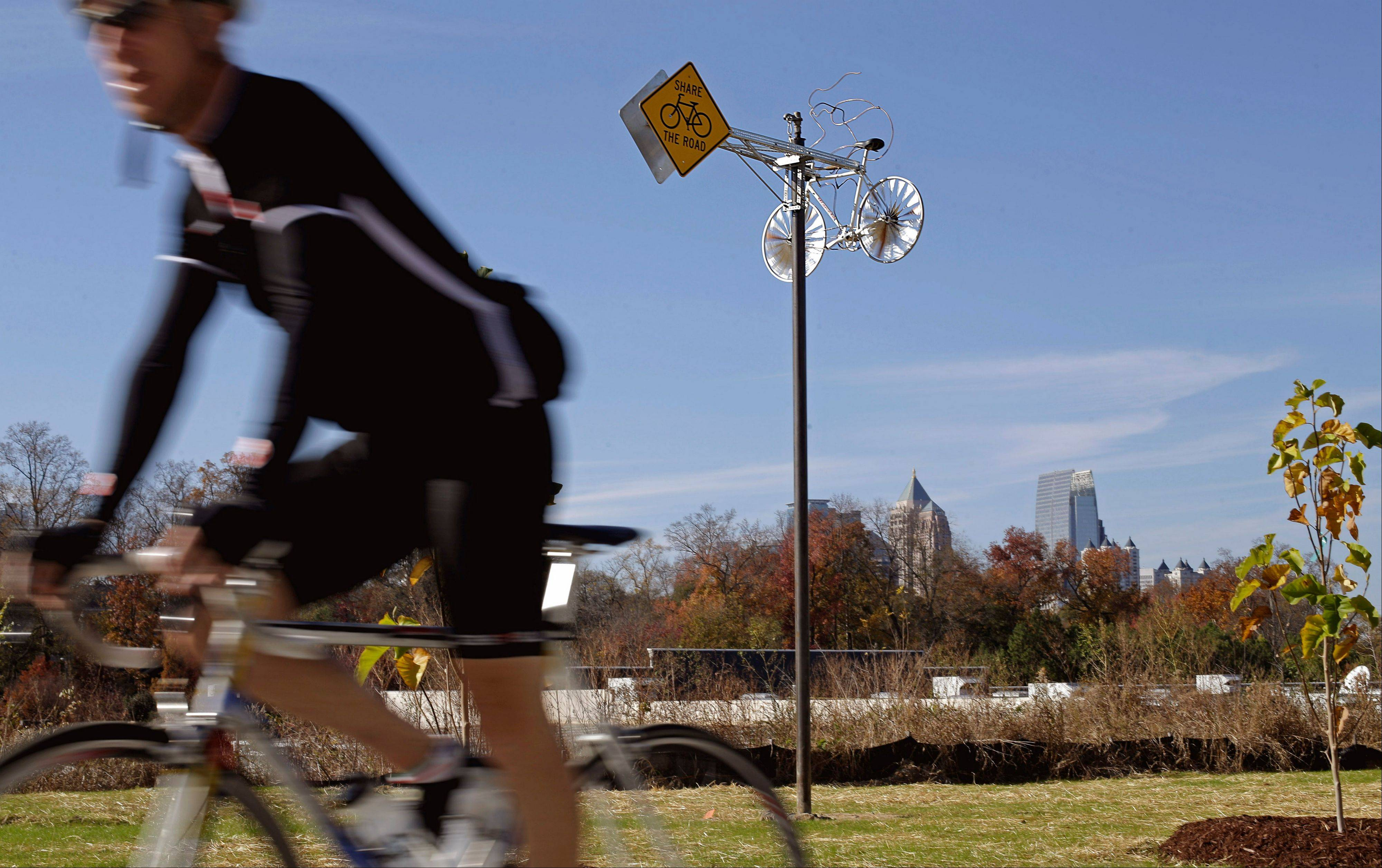 "Alex Rodriguez' public art project titled ""Whirling Wheels,"" is seen against the midtown skyline along the BeltLine in Atlanta."