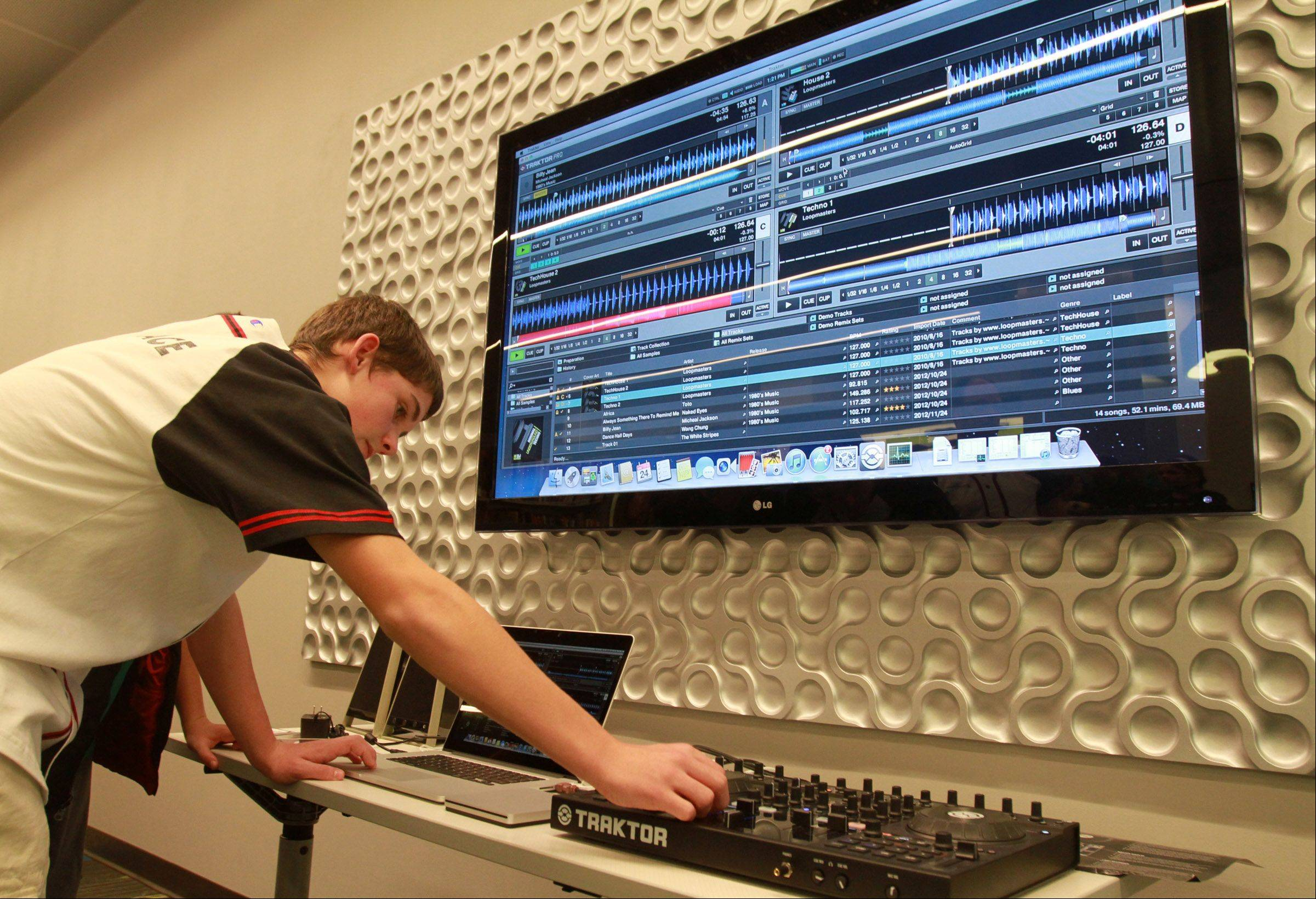 Matt Mussman, 15, of Schaumburg, samples audio Saturday in Schaumburg Township District Library's Teen Place digital music creation station. Teen Place is a state-of-the-art, 6,000-square-foot multipurpose area full of new technology that community teens can use for school, skill building, group projects and creative fun.