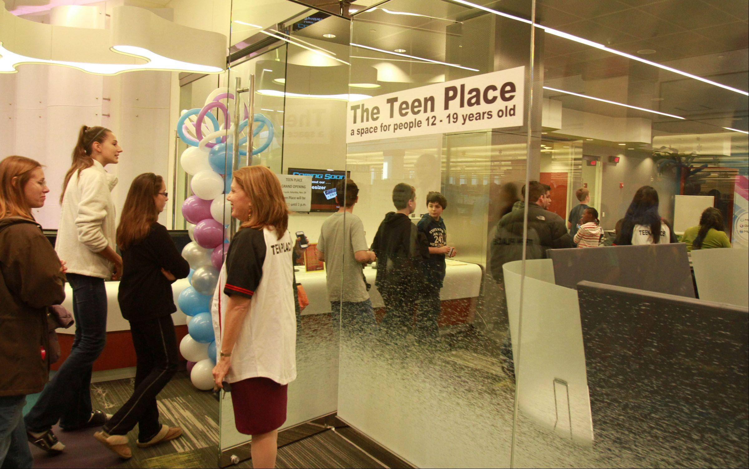 About 200 library patrons attended the Schaumburg Township District Library ribbon-cutting and grand opening Saturday for Teen Place at the library in Schaumburg.