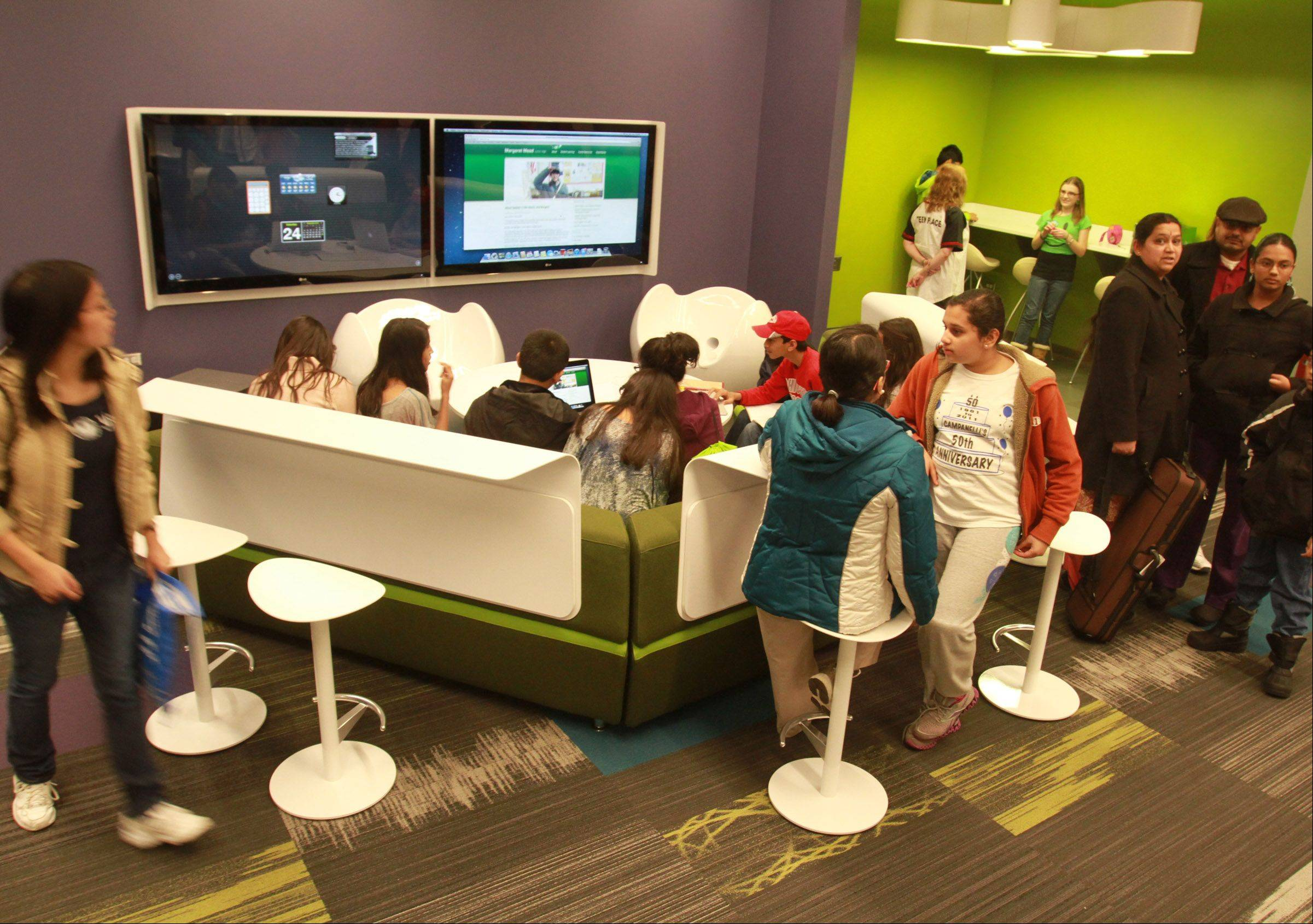 The Schaumburg Township District Library held a ribbon-cutting and grand opening for the Teen Place at the library in Schaumburg on Saturday. Teen Place is a state-of-the-art, 6,000-square-foot multipurpose area full of new technology that community teens can use for school, skill building, group projects and creative fun.