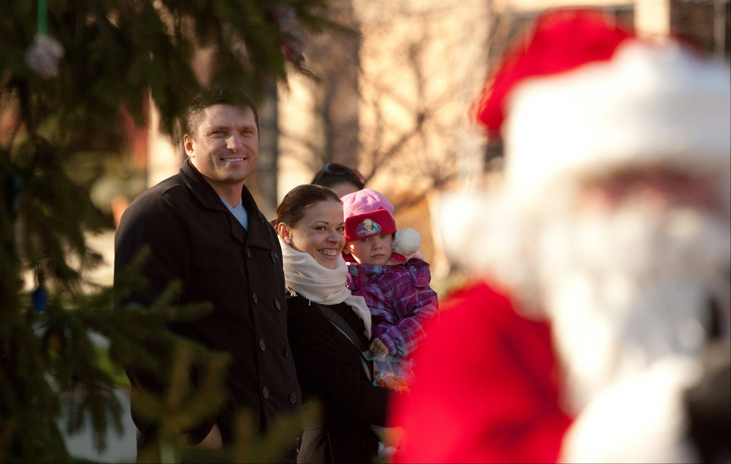 The Cipkute family of Streamwood watches as Santa gets ready to light the tree Saturday during Celebrate the Season at the Roselle Public Library.