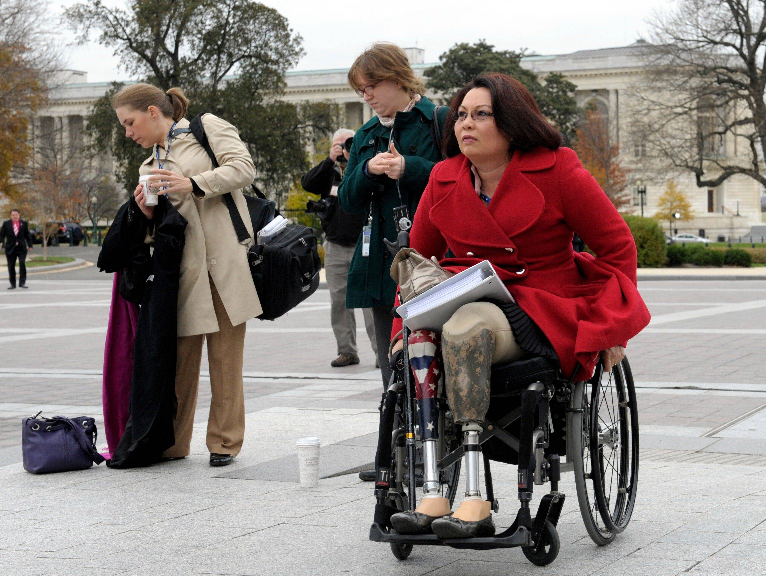 Rep.-elect Tammy Duckworth, who lost both legs in combat before turning to politics, arrives for a group photo on the East steps of the Capitol in Washington. Veterans groups say the influx of Iraq and Afghanistan veterans in Congress is welcome because it comes at a time when the overall number of veterans in Congress is on a steep and steady decline. In the mid-1970s, the vast majority of lawmakers tended to be veterans.