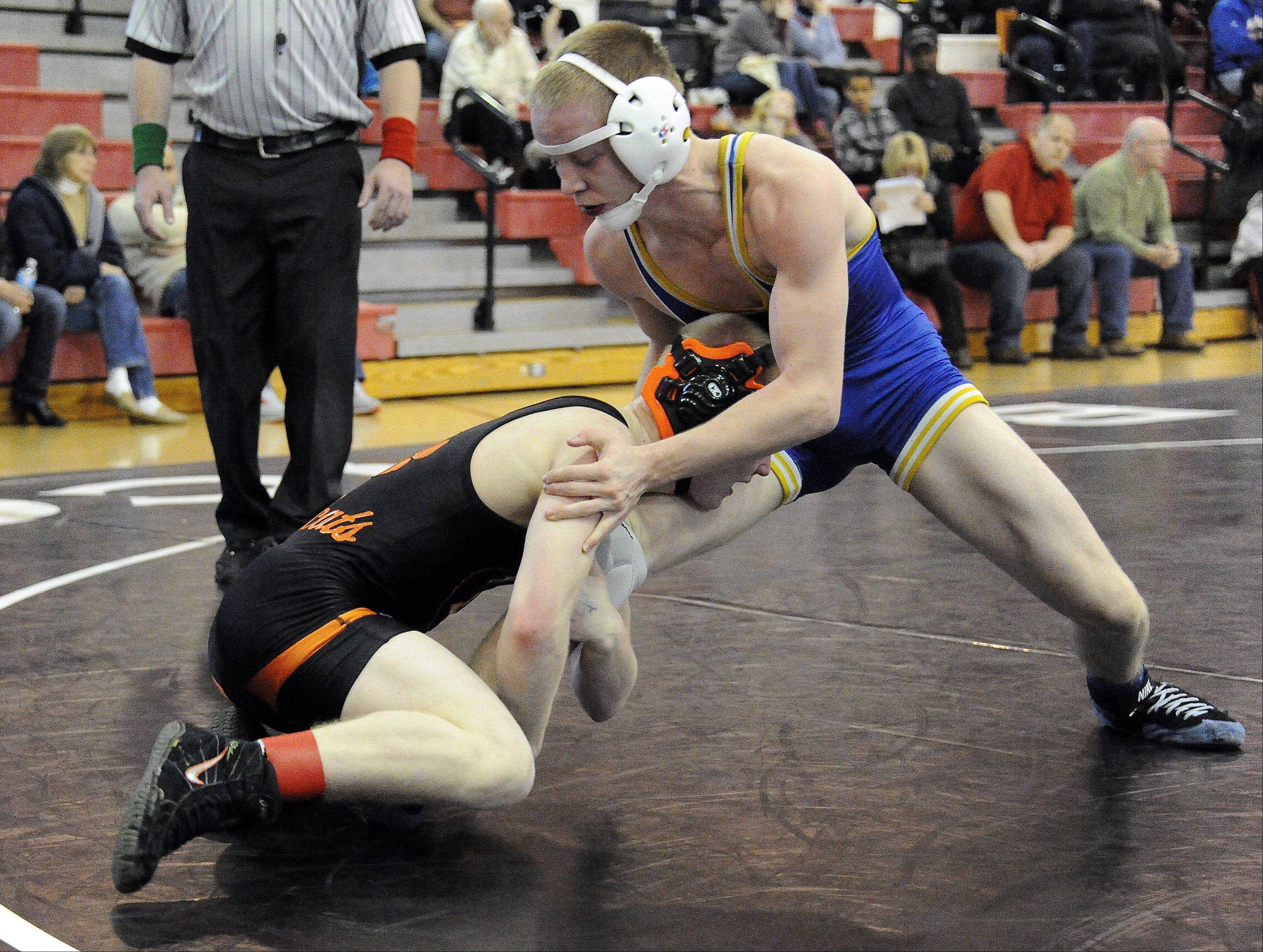 Steve Polakowski of Libertyville handles Kegan Calkins of Wheaton North at 120 pounds during the 22nd Annual Moore/Prettyman Wrestling Invitational at Barrington High School on Saturday.