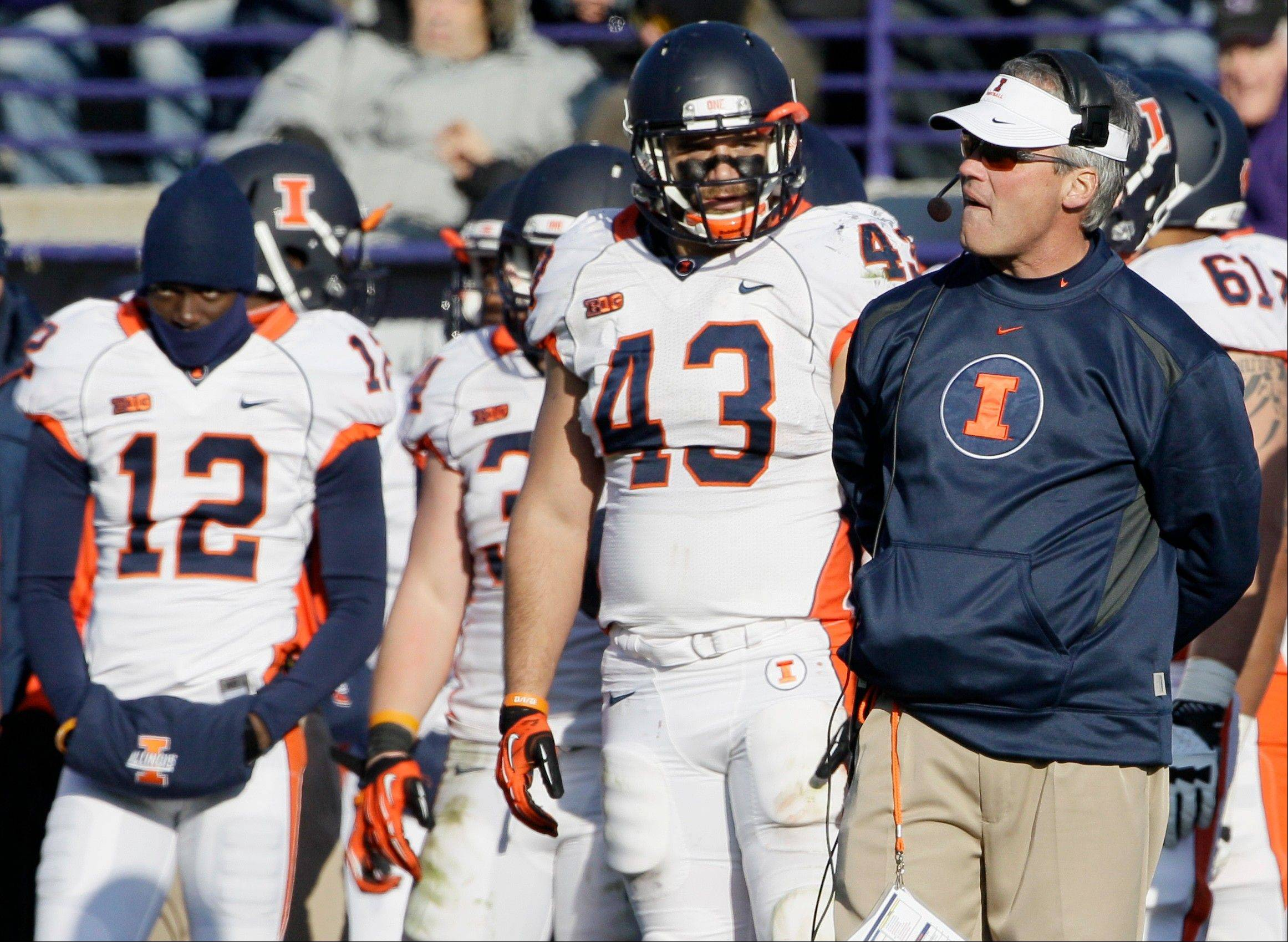 Illinois head coach Tim Beckman, right, reacts as he watches his team Saturday during the second half against Northwestern in Evanston. Northwestern won 50-14.