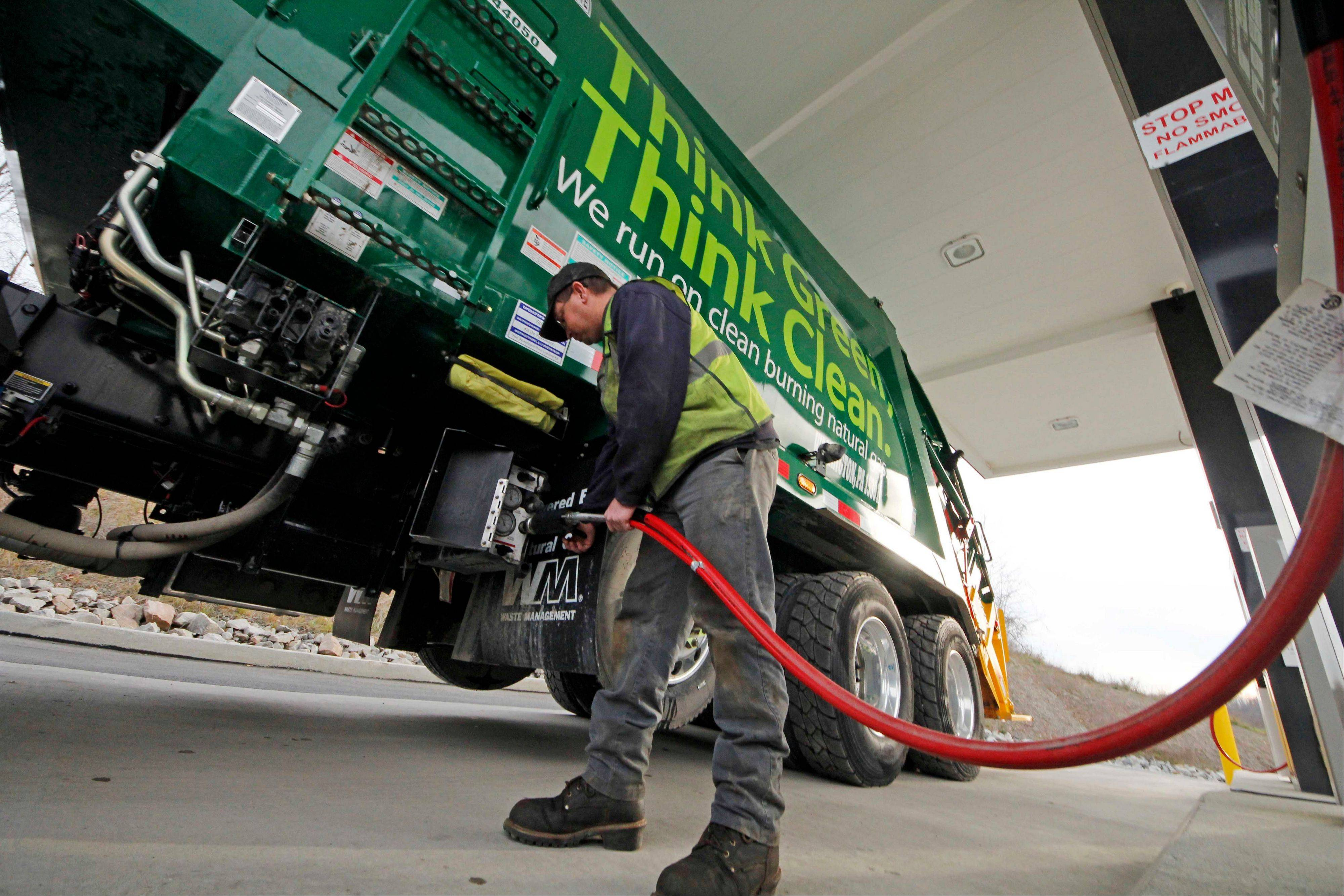 A Waste Management driver fills his truck with CNG gas at the company�s filling station in Washington, Pa. Years from now, motorists needing a fill-up might see natural gas pumps sharing space at the neighborhood filling station with ones dispensing gasoline and diesel.